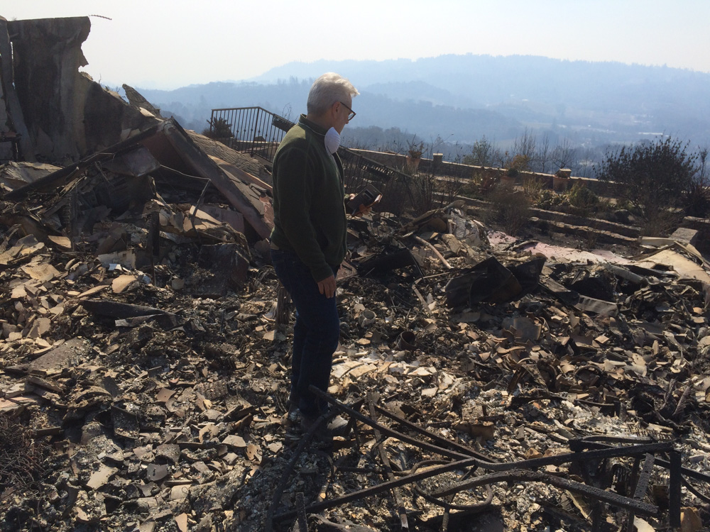 <div class='meta'><div class='origin-logo' data-origin='none'></div><span class='caption-text' data-credit='Dean Smith'>Homeowner Matt Afflixio surveys the remains of his home on Heights Drive in Santa Rosa, Calif.</span></div>