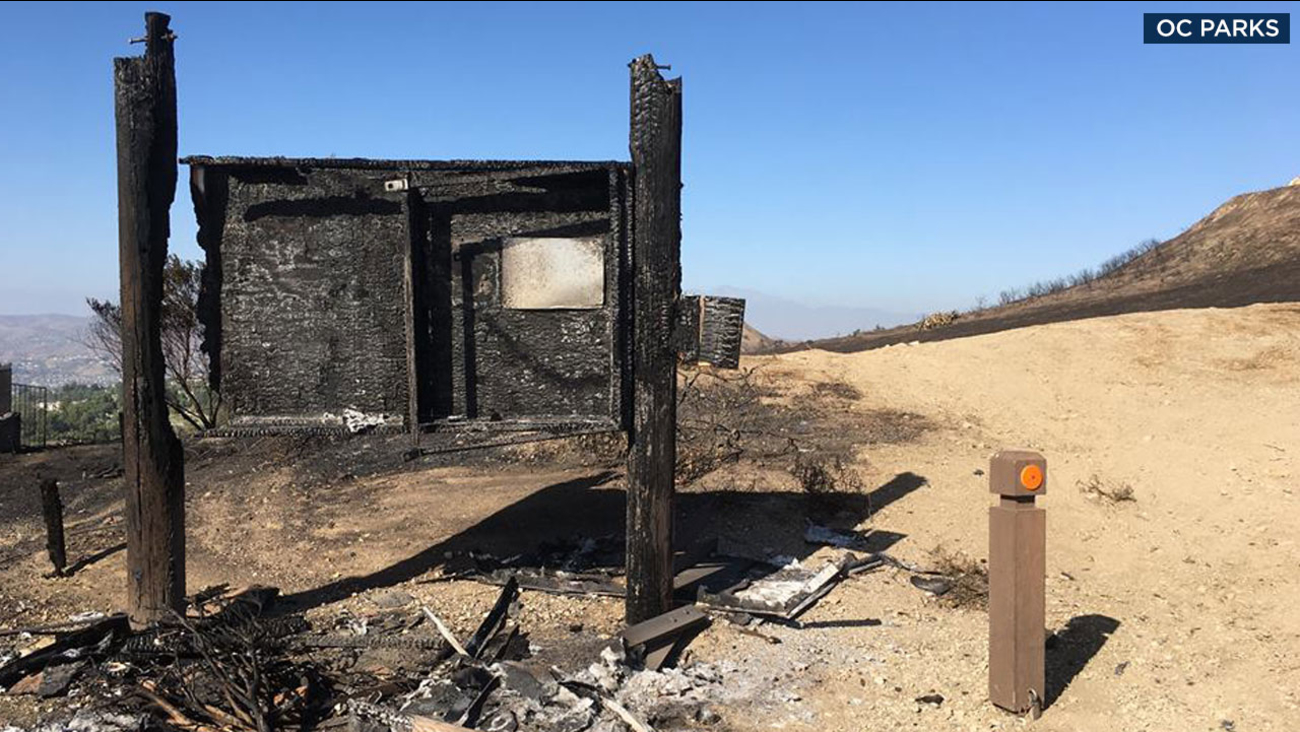 A building damaged by the Canyon Fire 2 at an Orange County regional park is shown in a photo.