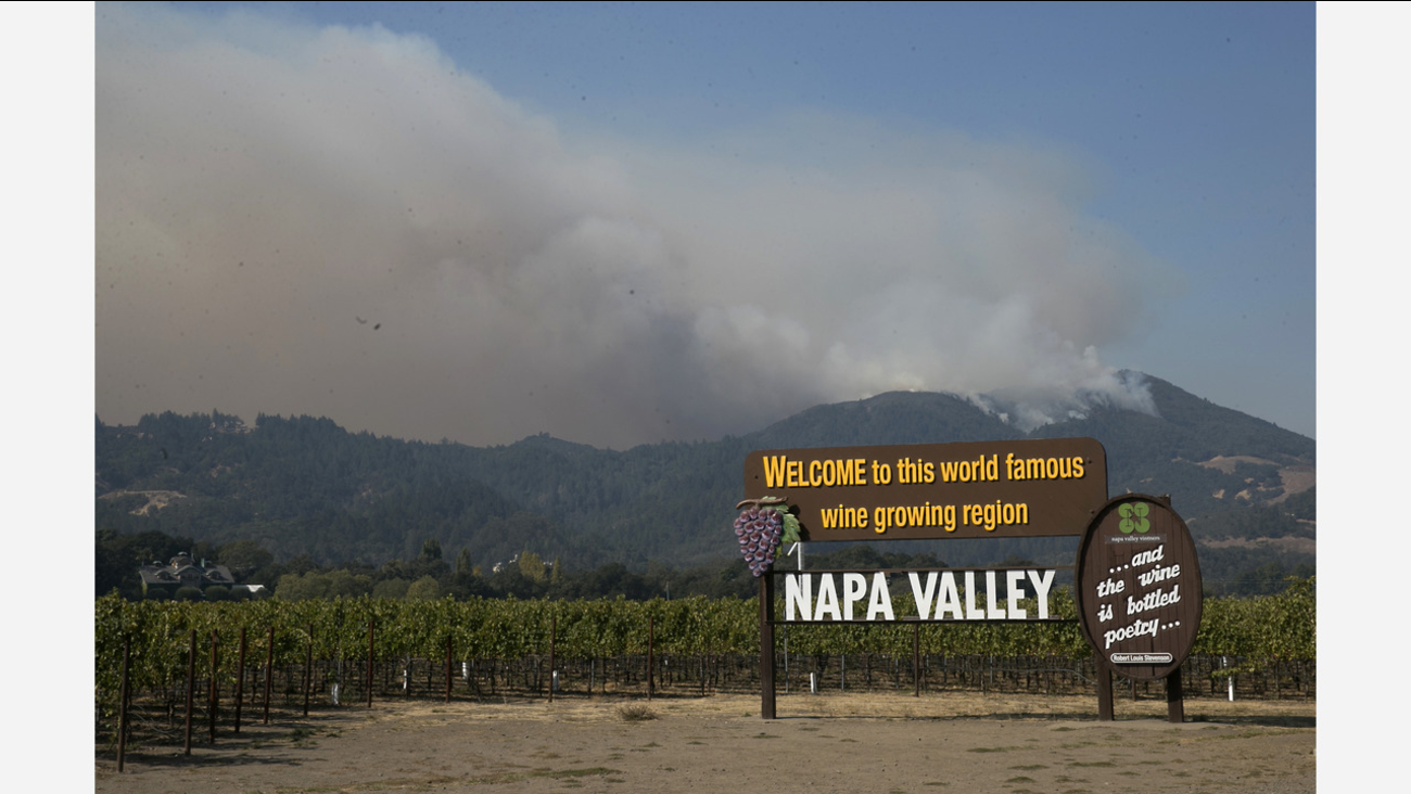 Smoke billows over Napa Valley Oct. 13, 2017. Firefighters gained ground on the blaze but face another tough day with high winds expected to return. (AP Photo/Rich Pedroncelli)