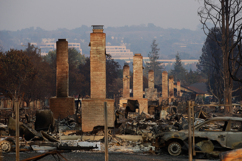 "<div class=""meta image-caption""><div class=""origin-logo origin-image none""><span>none</span></div><span class=""caption-text"">A row of chimneys stand in a neighborhood devastated by a wildfire Friday, Oct. 13, 2017, near Santa Rosa, Calif. (Jae C. Hong/AP Photo)</span></div>"