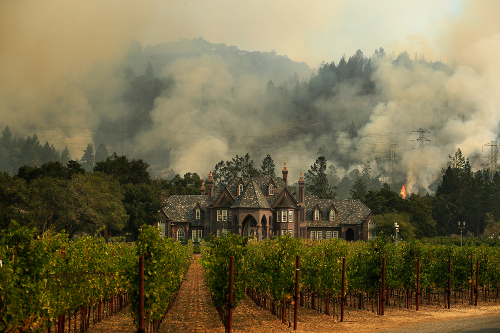 "<div class=""meta image-caption""><div class=""origin-logo origin-image none""><span>none</span></div><span class=""caption-text"">A wildfire burns behind a winery Saturday, Oct. 14, 2017, in Santa Rosa, Calif. (Jae C. Hong/AP Photo)</span></div>"