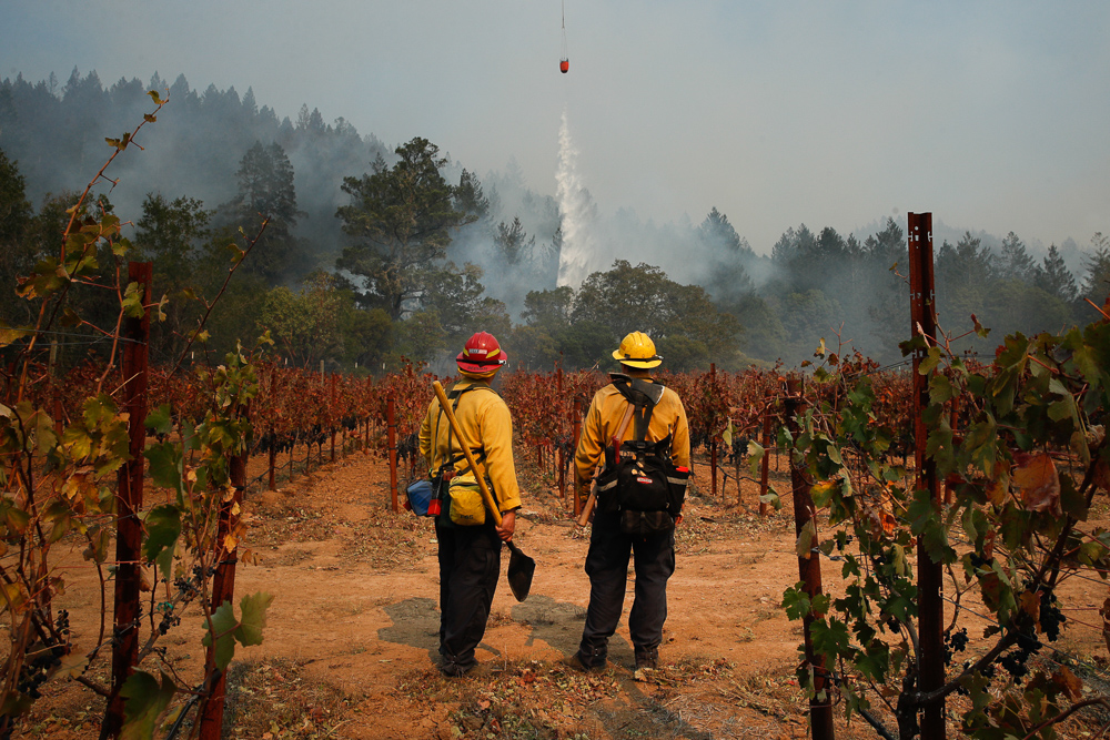<div class='meta'><div class='origin-logo' data-origin='none'></div><span class='caption-text' data-credit='Jae C. Hong/AP Photo'>Firefighters Mike Beeman, left, and Chris Oliver watch as a helicopter drops water over a wildfire burning near a winery Saturday, Oct. 14, 2017, in Santa Rosa, Calif.</span></div>