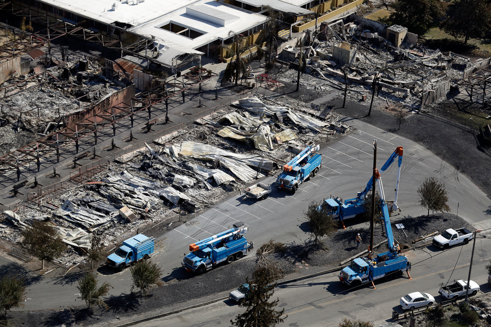 <div class='meta'><div class='origin-logo' data-origin='none'></div><span class='caption-text' data-credit='Marcio Jose Sanchez/AP Photo'>PG&E crews work on restoring power lines in a fire ravaged neighborhood in an aerial view in the aftermath of a wildfire Saturday, Oct. 14, 2017, in Santa Rosa, Calif.</span></div>