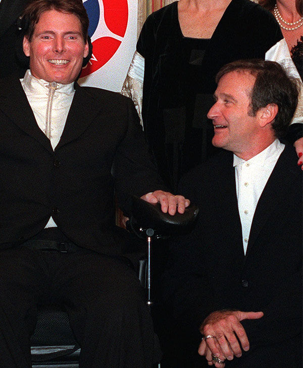 "<div class=""meta image-caption""><div class=""origin-logo origin-image ""><span></span></div><span class=""caption-text"">Williams putting a smile on ""Superman"" actor Christopher Reeve's face in 1998. (AP)</span></div>"