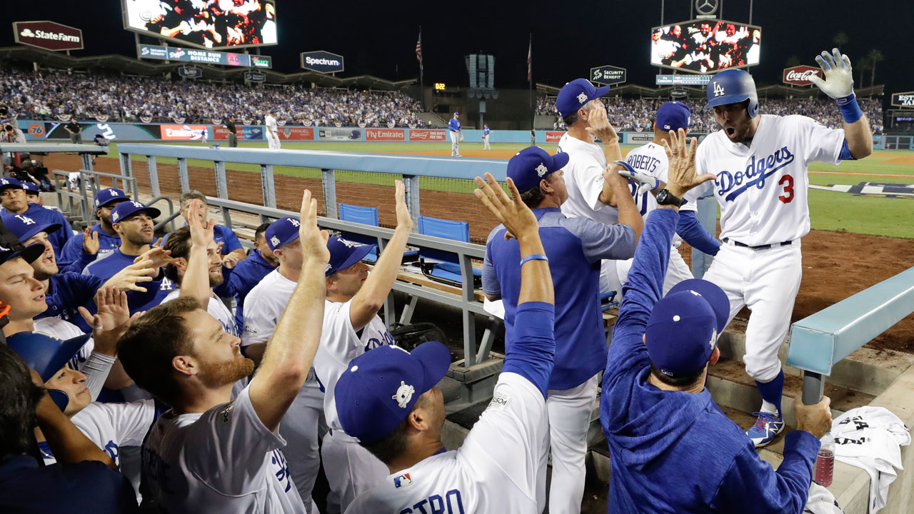 Los Angeles Dodgers' Chris Taylor returns to the dugout after hitting a home run against the Chicago Cubs during Game 1 of NLCS in Los Angeles, Saturday, Oct. 14, 2017.