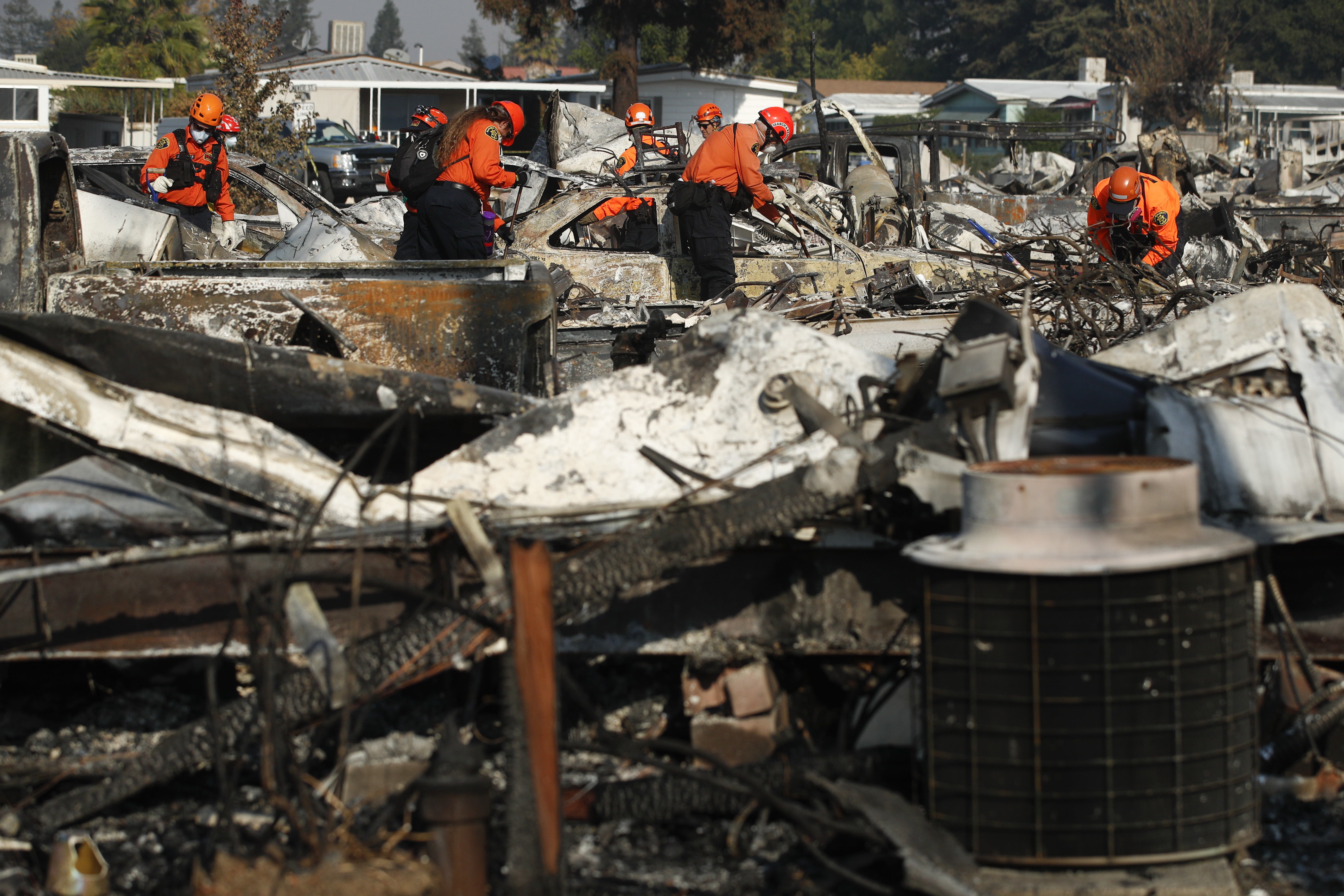 <div class='meta'><div class='origin-logo' data-origin='none'></div><span class='caption-text' data-credit='Jae C. Hong/AP Photo'>Members of a search and rescue team search through the rubble of mobile homes destroyed by a wildfire Monday, Oct. 16, 2017, in Santa Rosa, Calif.</span></div>