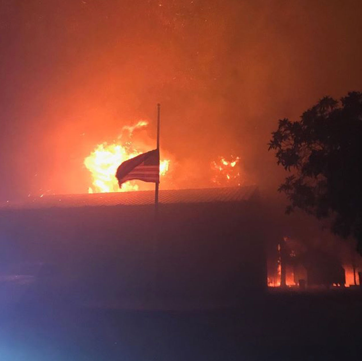 "<div class=""meta image-caption""><div class=""origin-logo origin-image none""><span>none</span></div><span class=""caption-text"">An American flag flies as the Tubbs fire burns behind it. (local55oakland/Instagram)</span></div>"