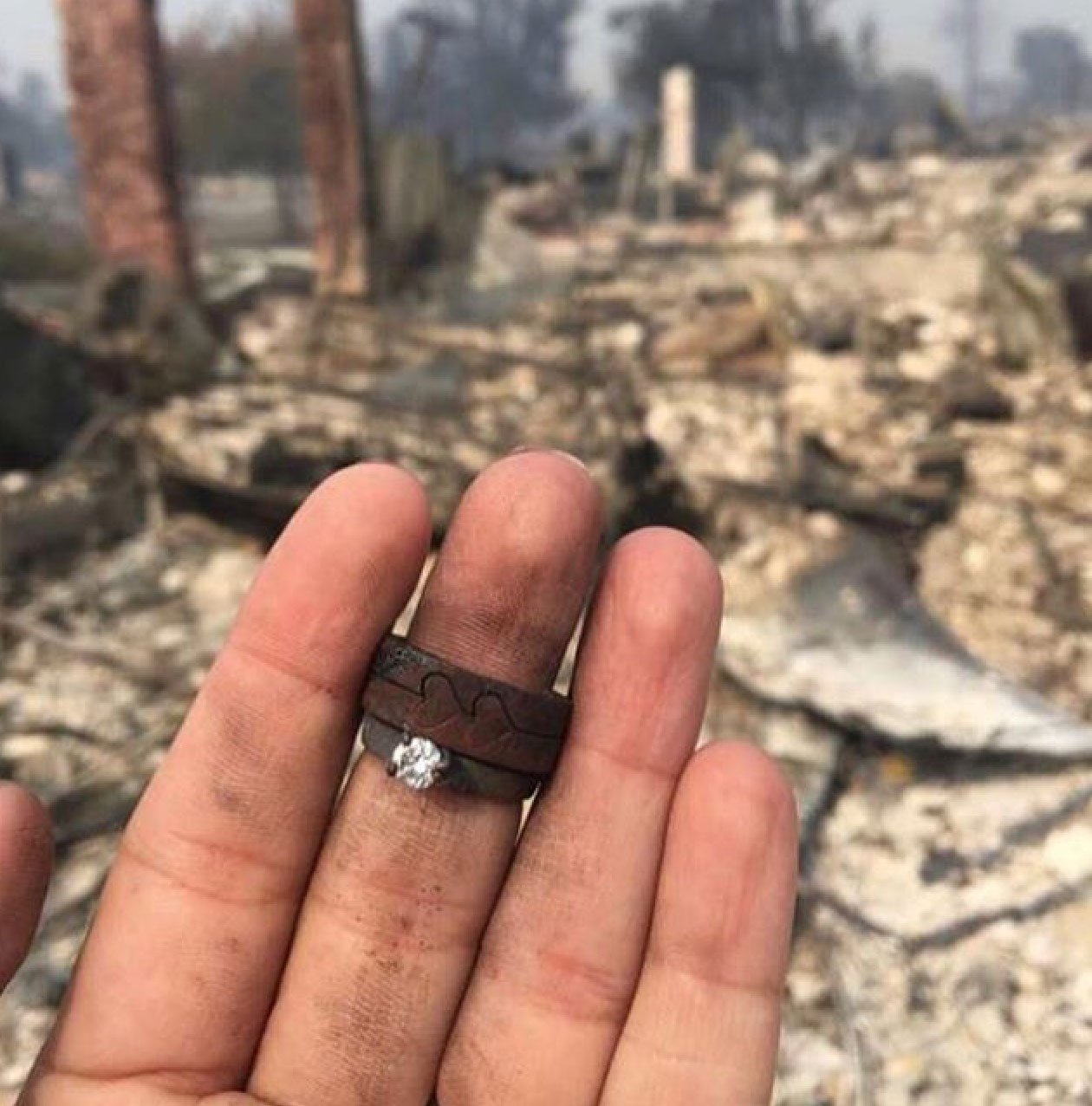 <div class='meta'><div class='origin-logo' data-origin='none'></div><span class='caption-text' data-credit='djgraystone/Instagram'>These rings were found in the rubble of a home, the person who took the photo said. It was captioned, ''Today, tomorrow, and everyday after that you need to love harder...''</span></div>