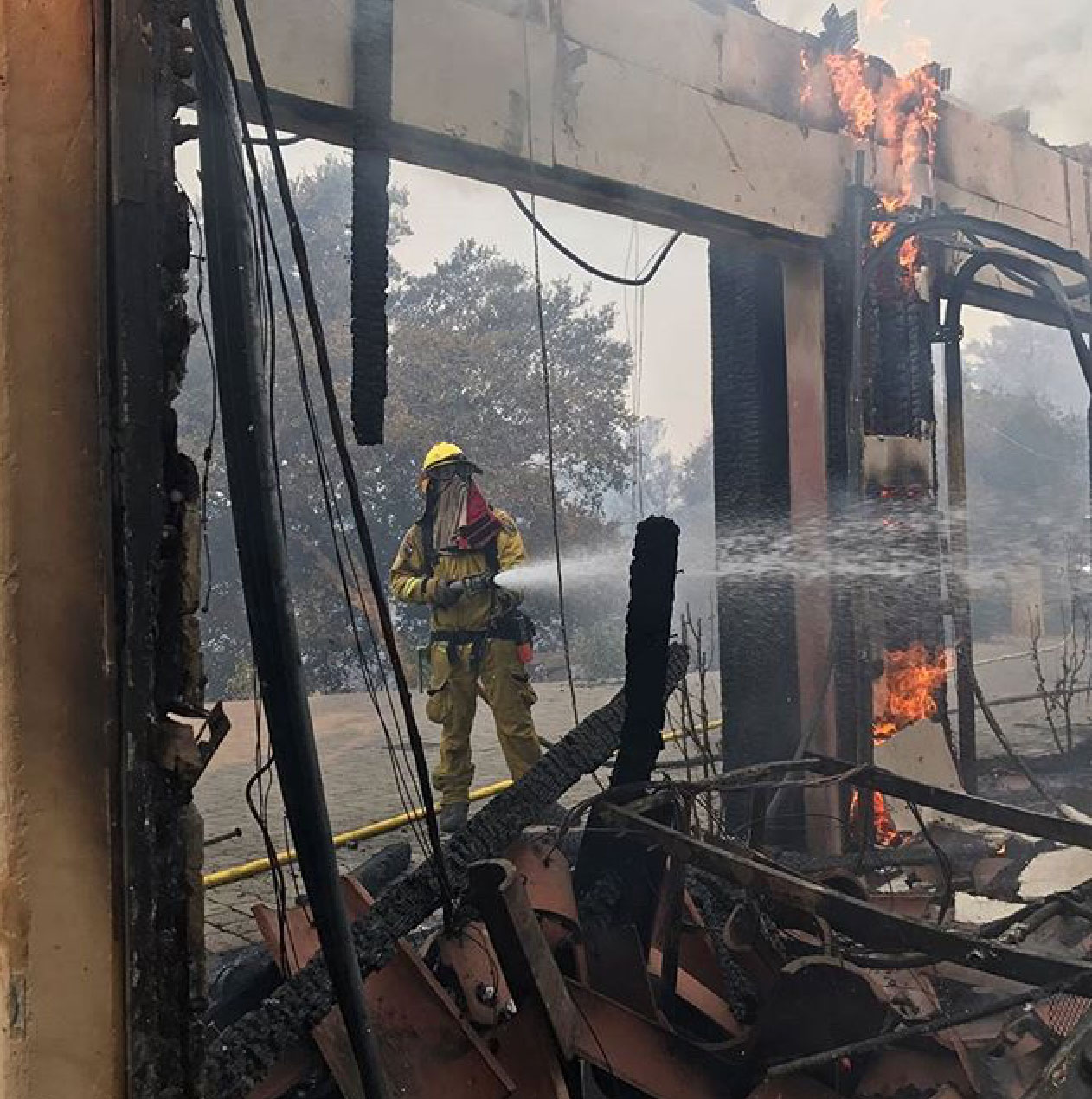 <div class='meta'><div class='origin-logo' data-origin='none'></div><span class='caption-text' data-credit='calfire/Instagram'>CalFire shared this photo of a firefighter in action.</span></div>