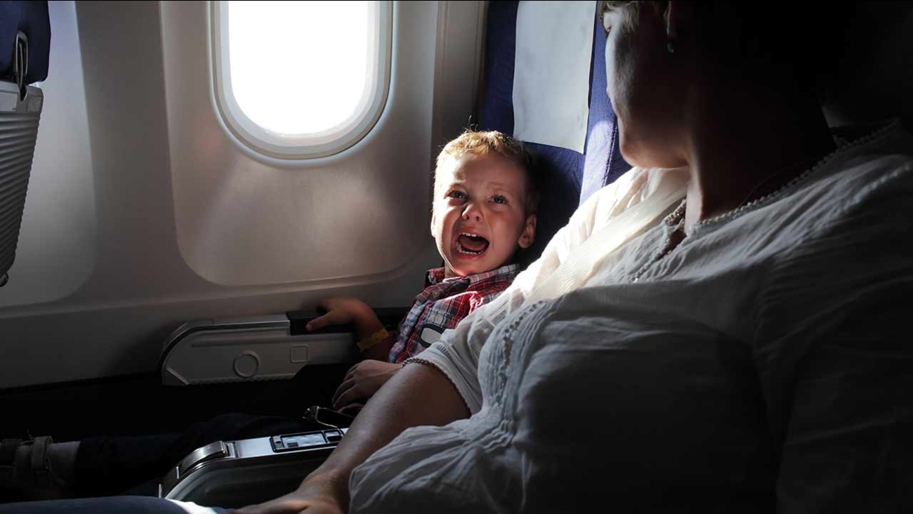 child crying on a plane