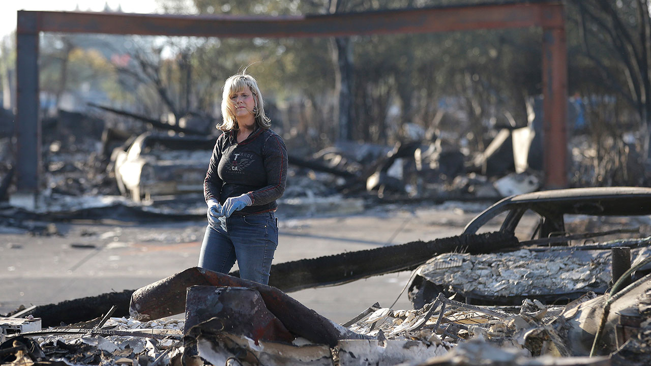 "<div class=""meta image-caption""><div class=""origin-logo origin-image none""><span>none</span></div><span class=""caption-text"">Debbie Wolfe looks over the burned ruins of her home of 30 years Tuesday, Oct. 17, 2017, in Santa Rosa, Calif. (Rich Pedroncelli/AP Photo)</span></div>"