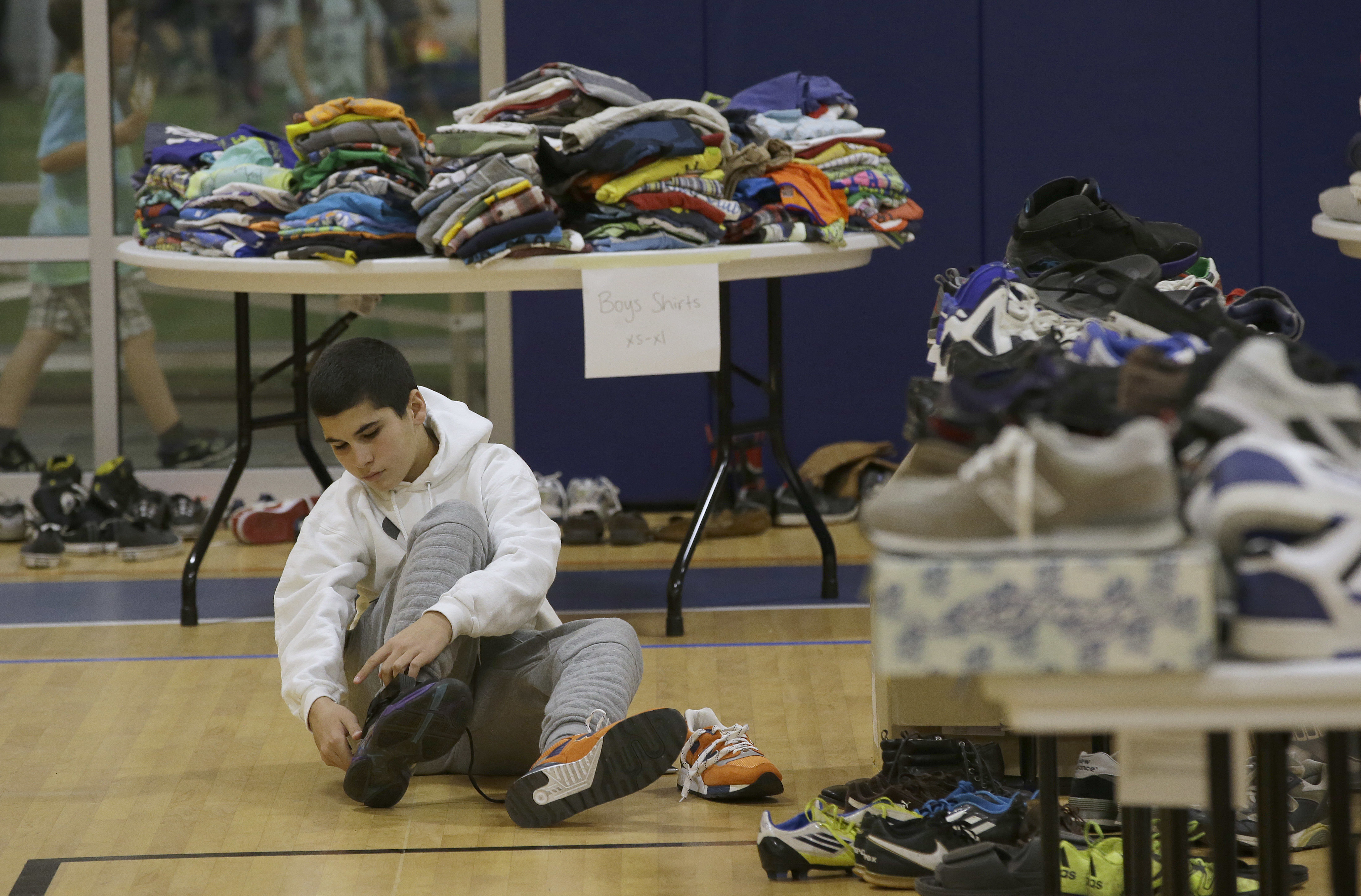 <div class='meta'><div class='origin-logo' data-origin='none'></div><span class='caption-text' data-credit='Rich Pedroncelli/AP Photo'>Mehdi Latrache, who lost his home, tries on shoes at a donation center for victims of the recent wildfires, Tuesday, Oct. 17, 2017, in Santa Rosa, Calif.</span></div>