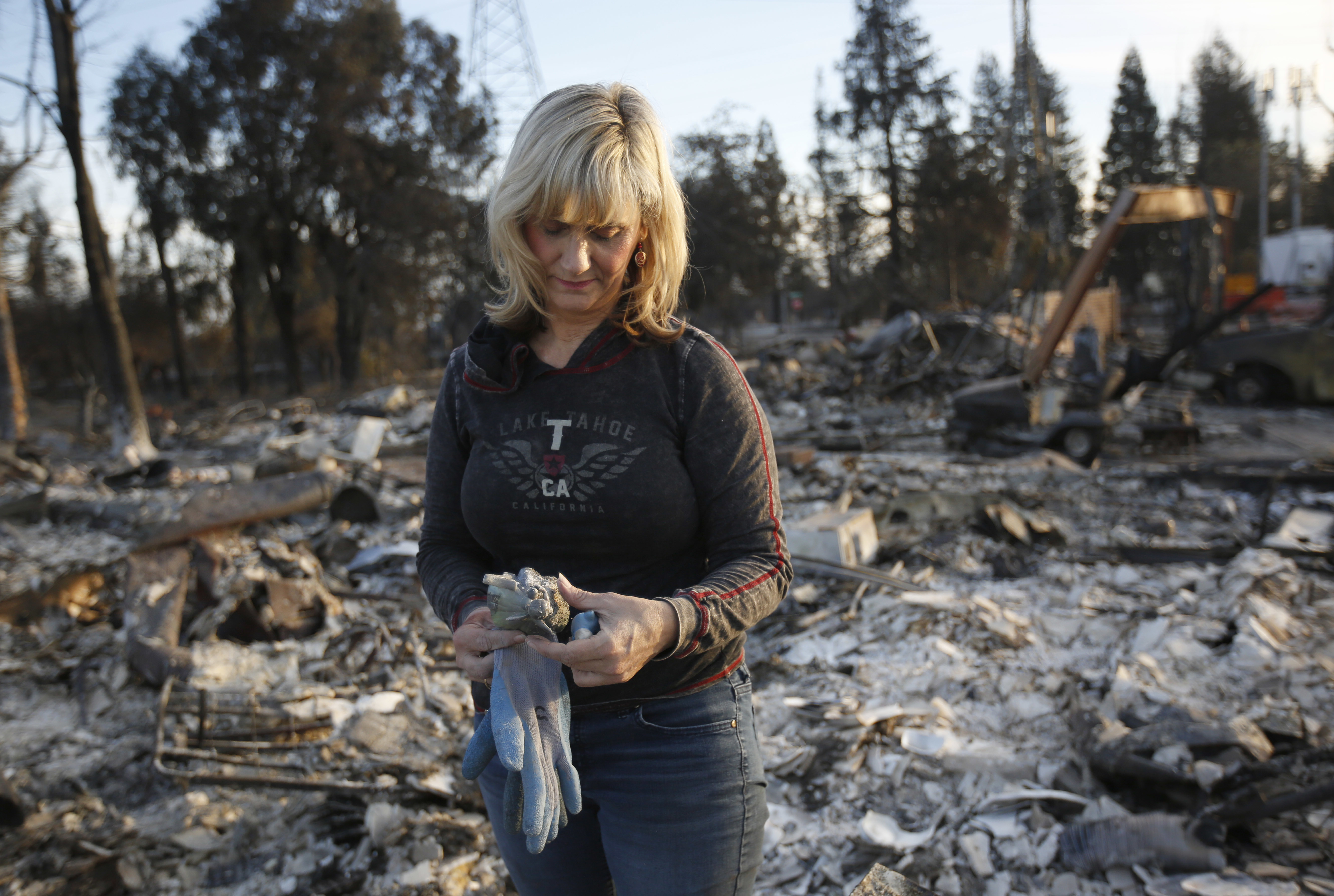 <div class='meta'><div class='origin-logo' data-origin='none'></div><span class='caption-text' data-credit='Rich Pedroncelli/AP Photo'>Debbie Wolfe stares at the broken figurine, she found in the burned ruins of her home Tuesday, Oct. 17, 2017, in Santa Rosa, Calif.</span></div>