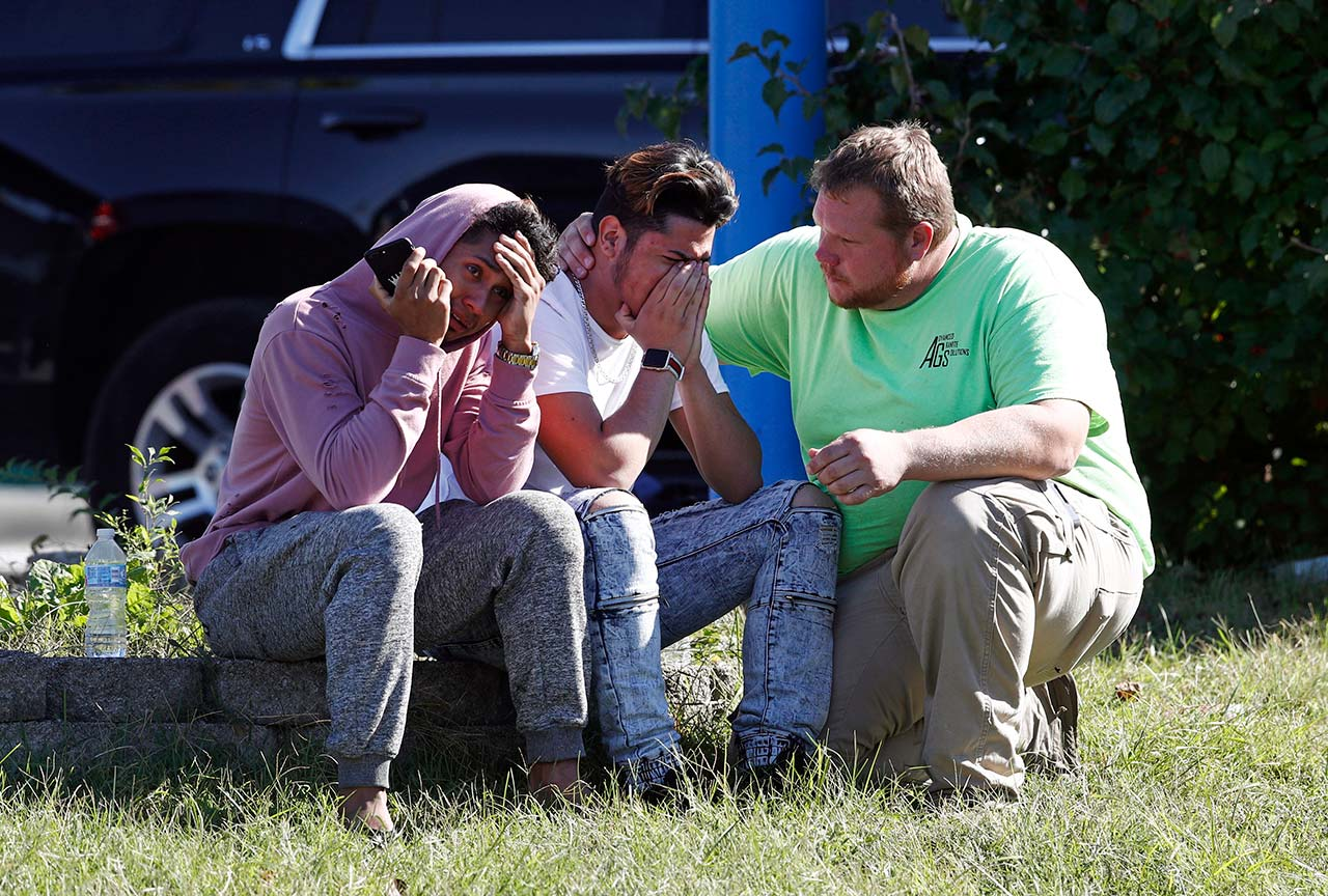 <div class='meta'><div class='origin-logo' data-origin='none'></div><span class='caption-text' data-credit=''>People gather across the street from the scene of a shooting at a business park in the Edgewood area of Harford County, Md. (AP Photo/Patrick Semansky)</span></div>