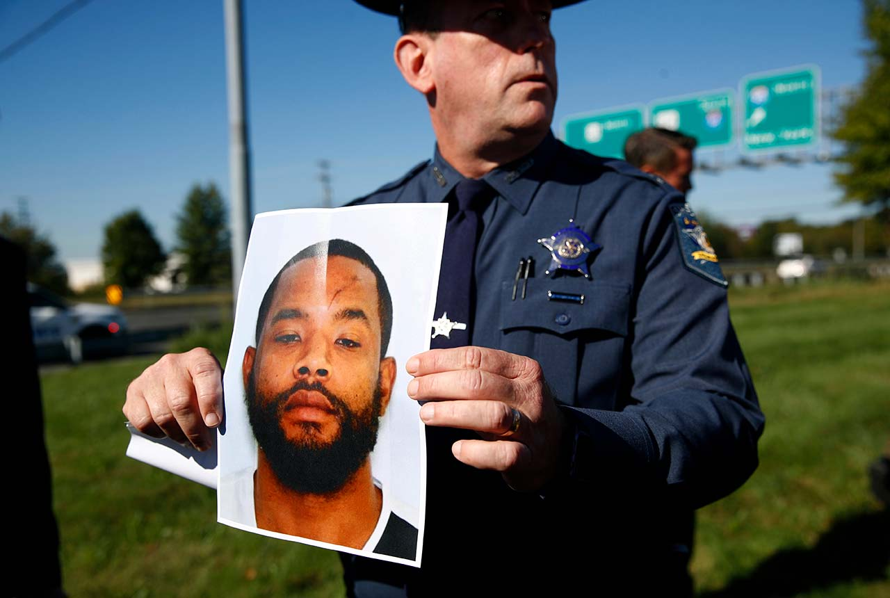 <div class='meta'><div class='origin-logo' data-origin='none'></div><span class='caption-text' data-credit=''>Harford County Sheriff Jeffrey Gahler displays a photo of Radee Labeeb Prince, the suspect in the shooting at a business park in Maryland (AP Photo/Patrick Semansky)</span></div>