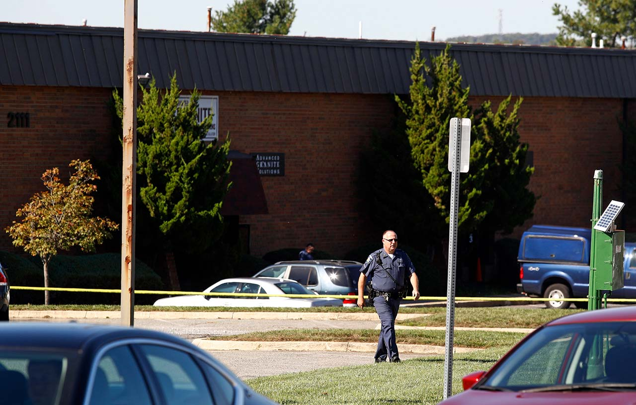 <div class='meta'><div class='origin-logo' data-origin='none'></div><span class='caption-text' data-credit=''>A law enforcement official walks away from the scene of a fatal shooting at a business park in the Edgewood area of Harford County, Md. (AP Photo/Patrick Semansky)</span></div>