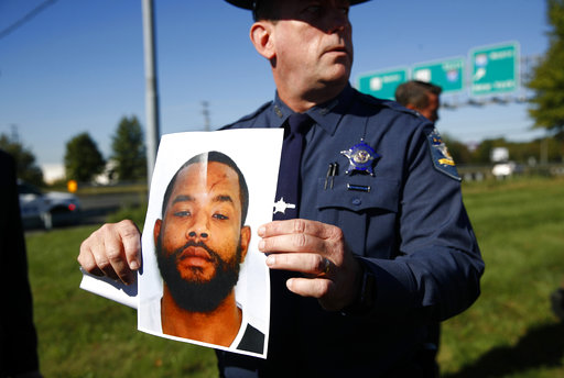 <div class='meta'><div class='origin-logo' data-origin='none'></div><span class='caption-text' data-credit='AP'>Harford County Sheriff Jeffrey Gahler displays a photo of Radee Prince, the suspect in a shooting at a business park in the Edgewood area of Harford County, Md., Oct. 18, 2017.</span></div>