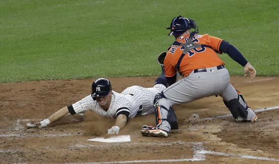 <div class='meta'><div class='origin-logo' data-origin='AP'></div><span class='caption-text' data-credit='David J. Phillip'>New York Yankees' Brett Gardner scores past Houston Astros catcher Brian McCann during the third inning of Game 5 of baseball's American League Championship Series.</span></div>