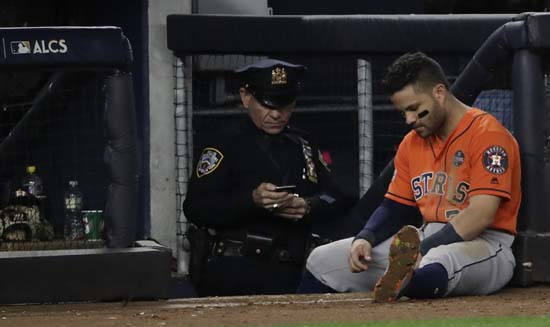 <div class='meta'><div class='origin-logo' data-origin='AP'></div><span class='caption-text' data-credit='David J. Phillip'>Houston Astros' Jose Altuve sits near the dugout during the ninth inning of Game 5 of baseball's American League Championship Series.</span></div>