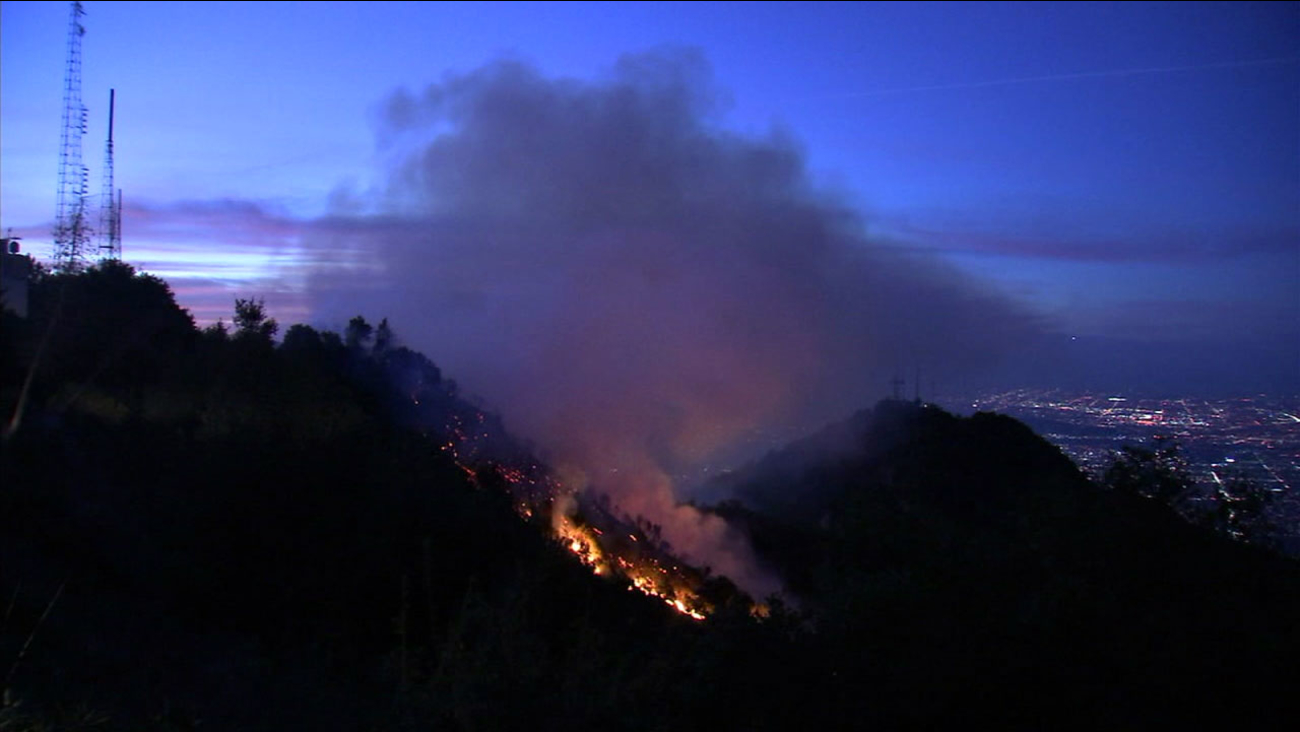 Flames and smoke are shown in the hillsides of Mount Wilson as a brush fire broke out in the early morning hours of Tuesday, Oct. 17, 2017.