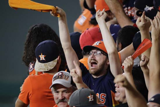 <div class='meta'><div class='origin-logo' data-origin='AP'></div><span class='caption-text' data-credit='AP'>Houston Astros fans cheer during the fourth inning of Game 7. (AP Photo/Charlie Riedel)</span></div>