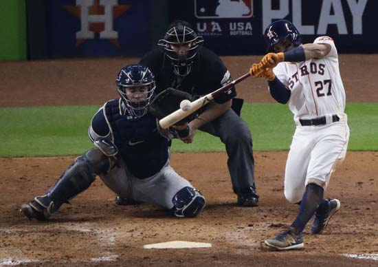 <div class='meta'><div class='origin-logo' data-origin='AP'></div><span class='caption-text' data-credit='AP'>Houston Astros' Jose Altuve hits a home run during the fifth inning of Game 7. (AP Photo/Charlie Riedel)</span></div>