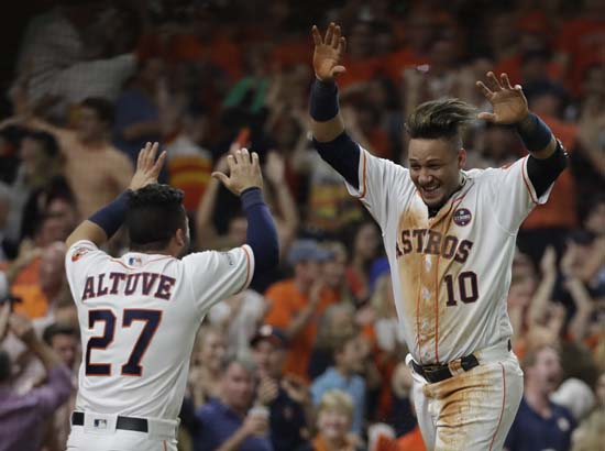 <div class='meta'><div class='origin-logo' data-origin='AP'></div><span class='caption-text' data-credit='AP'>Houston Astros' Yuli Gurriel is congratulated by Jose Altuve after scoring during the fifth inning of Game 7. (AP Photo/David J. Phillip)</span></div>