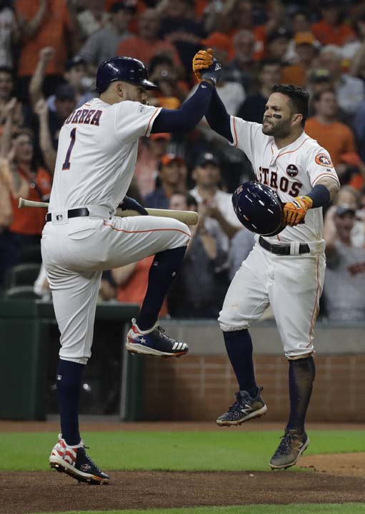 <div class='meta'><div class='origin-logo' data-origin='AP'></div><span class='caption-text' data-credit='AP'>Houston Astros' Jose Altuve is congratulated after hitting a home run during the fifth inning of Game 7. (AP Photo/David J. Phillip)</span></div>