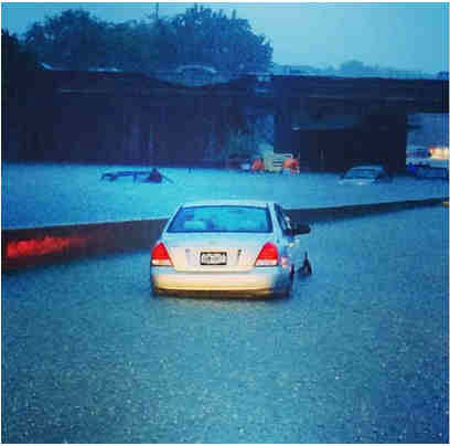 "<div class=""meta image-caption""><div class=""origin-logo origin-image ""><span></span></div><span class=""caption-text"">See images of flooding, stranded cars and downed trees after severe storms moved through the New York area overnight Wednesday. (Katherine McCormack)</span></div>"