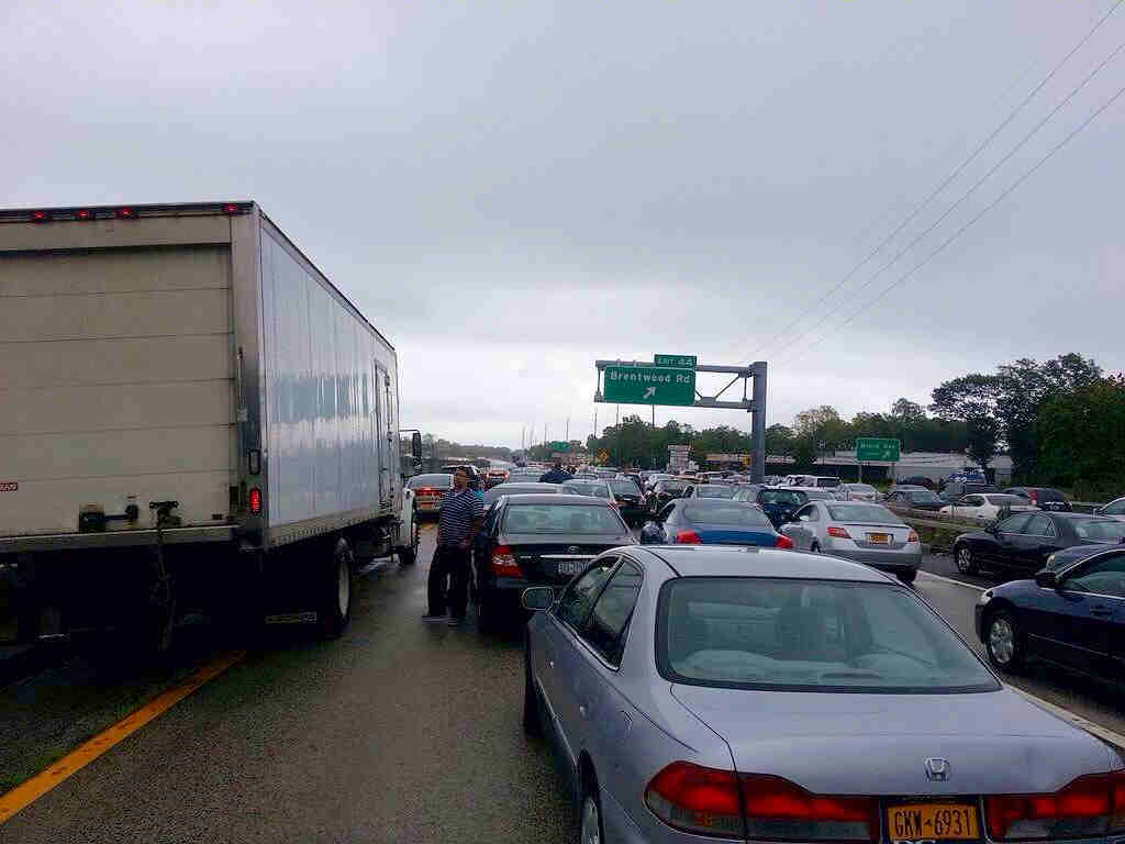 "<div class=""meta image-caption""><div class=""origin-logo origin-image ""><span></span></div><span class=""caption-text"">Traffic backup on Sunrise Highway at exit 44 because of flooding</span></div>"