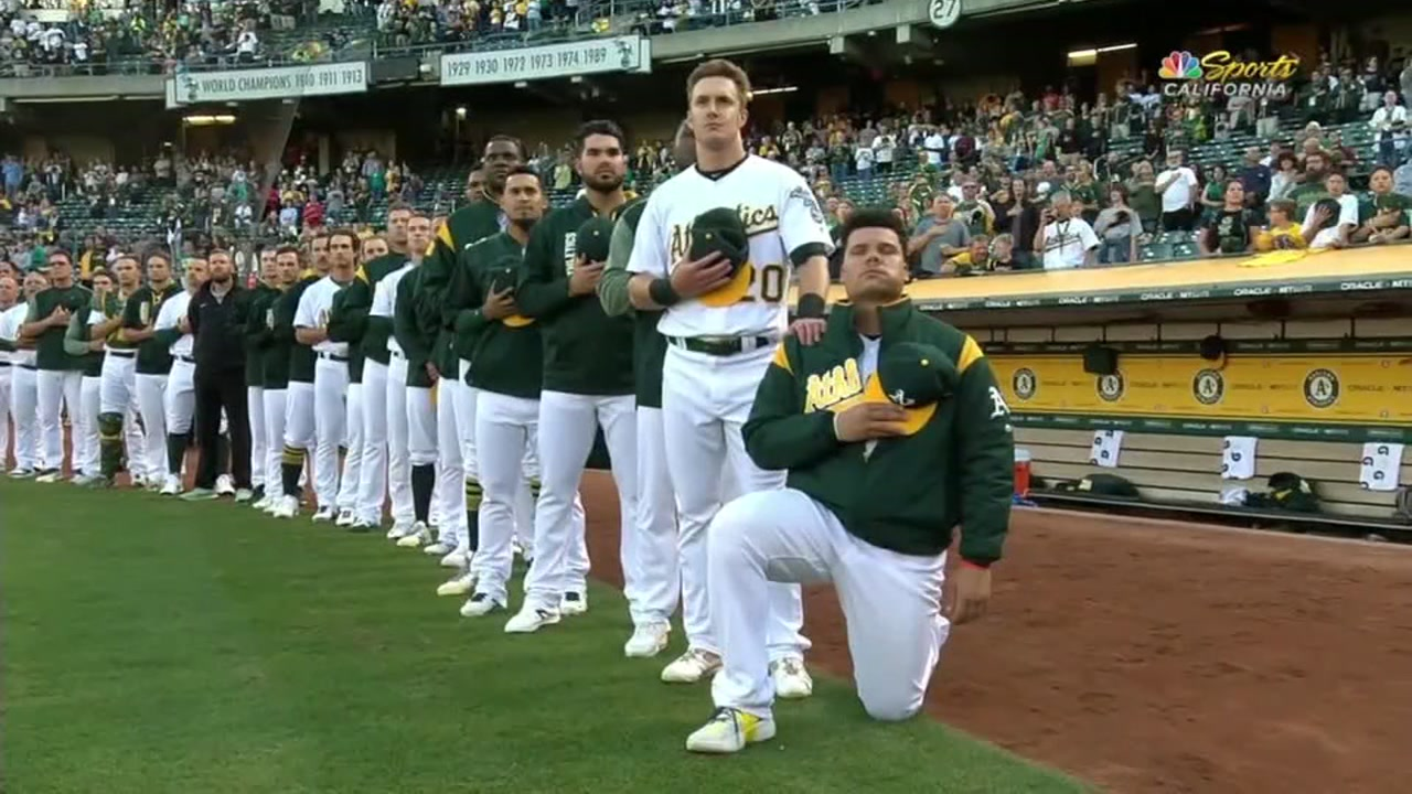 Bruce Maxwell kneels during an Oakland Athletics game in this undated image.