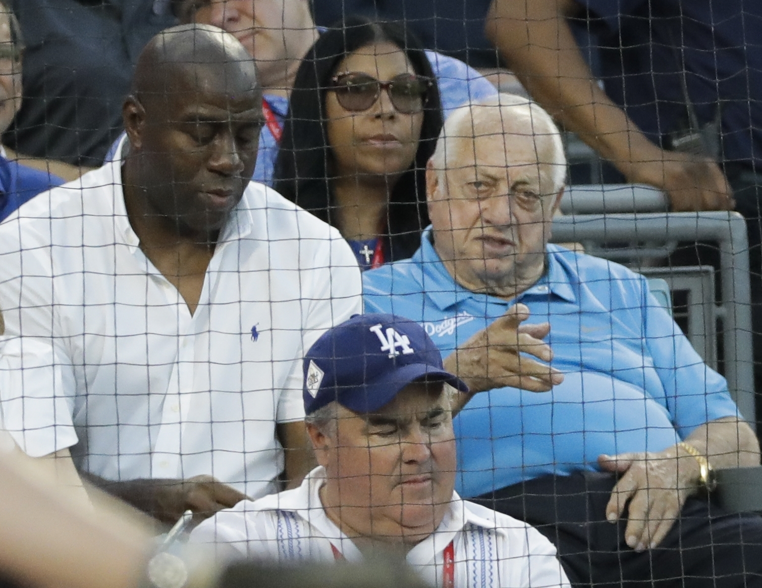 <div class='meta'><div class='origin-logo' data-origin='AP'></div><span class='caption-text' data-credit='(AP Photo/David J. Phillip)'>Magic Johnson and Tommy Lasorda watch during the second inning of Game 1 of baseball's World Series between the Houston Astros and the Los Angeles Dodgers Tuesday, Oct. 24, 2017.</span></div>