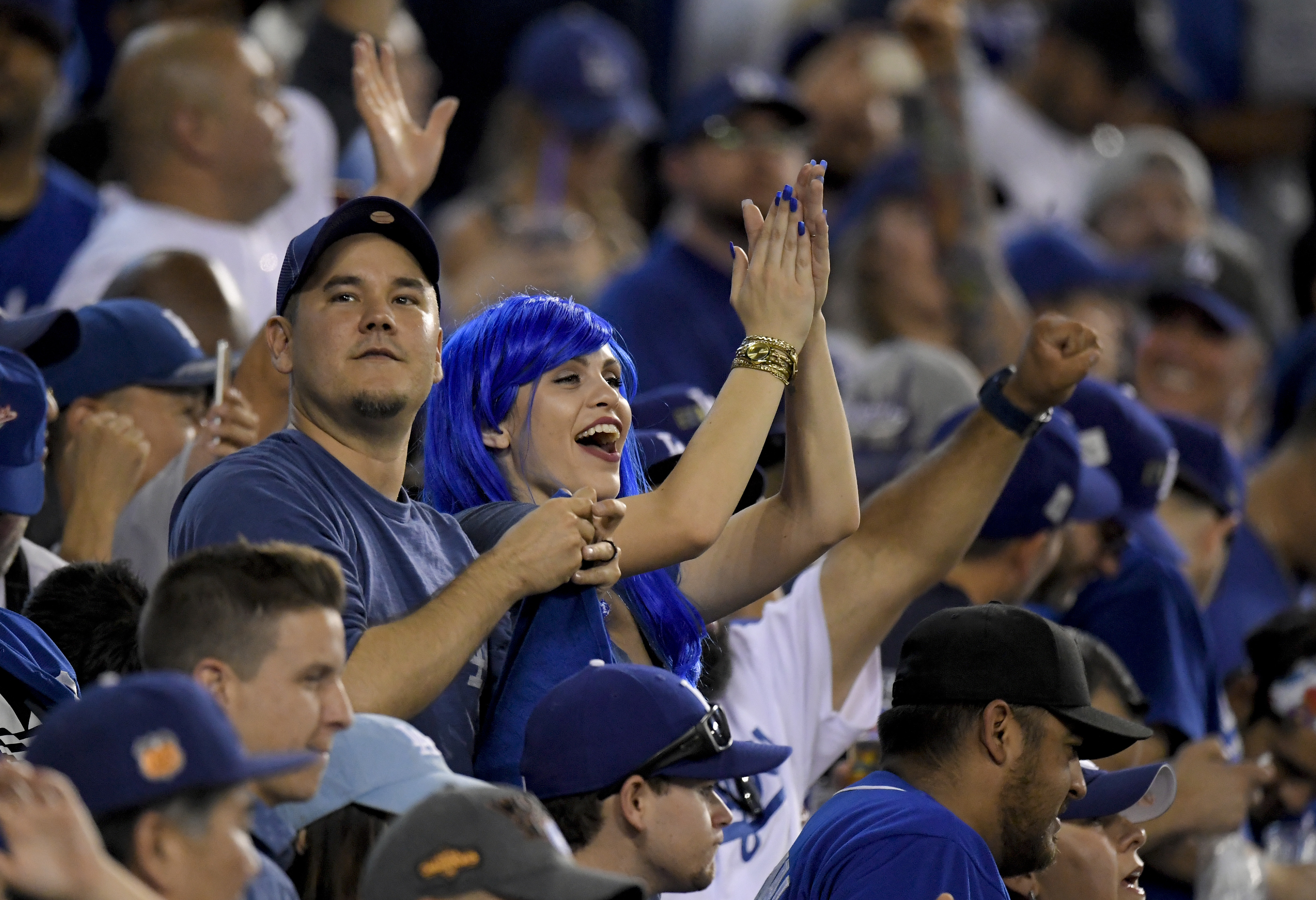 <div class='meta'><div class='origin-logo' data-origin='AP'></div><span class='caption-text' data-credit='(AP Photo/Mark J. Terrill)'>Fans react after the Dodgers win World Series Game 1 against the Houston Astros Tuesday, Oct. 24, 2017, in Los Angeles. The Dodgers won 3-1 to take a 1-0 lead in the series.</span></div>
