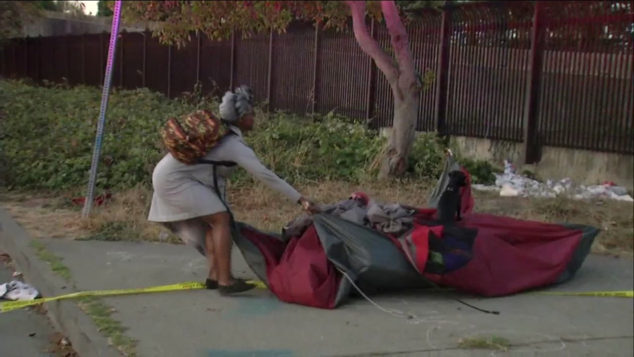 A person is seen moving belongings from a homeless encampment in Berkeley, Calif. on Wednesday, October 25, 2017.
