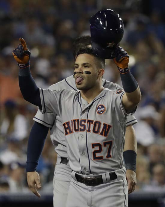 <div class='meta'><div class='origin-logo' data-origin='AP'></div><span class='caption-text' data-credit='AP'>Houston Astros' Jose Altuve reacts after hitting a home run during the 10th inning of Game 2 of baseball's World Series against the Los Angeles Dodgers. (AP Photo/David J. Phillip)</span></div>