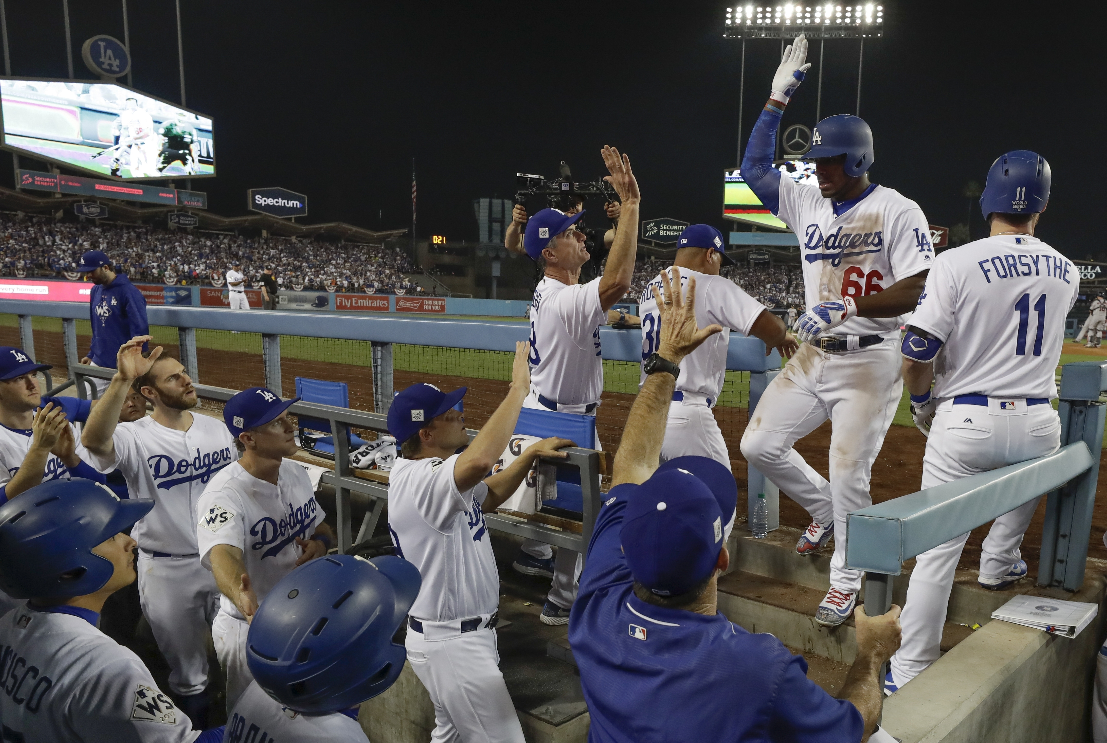 <div class='meta'><div class='origin-logo' data-origin='AP'></div><span class='caption-text' data-credit='(AP Photo/Matt Slocum)'>Los Angeles Dodgers' Yasiel Puig is congratulated after hitting a home run during the 10th inning of Game 2 of baseball's World Series against the Houston Astros.</span></div>