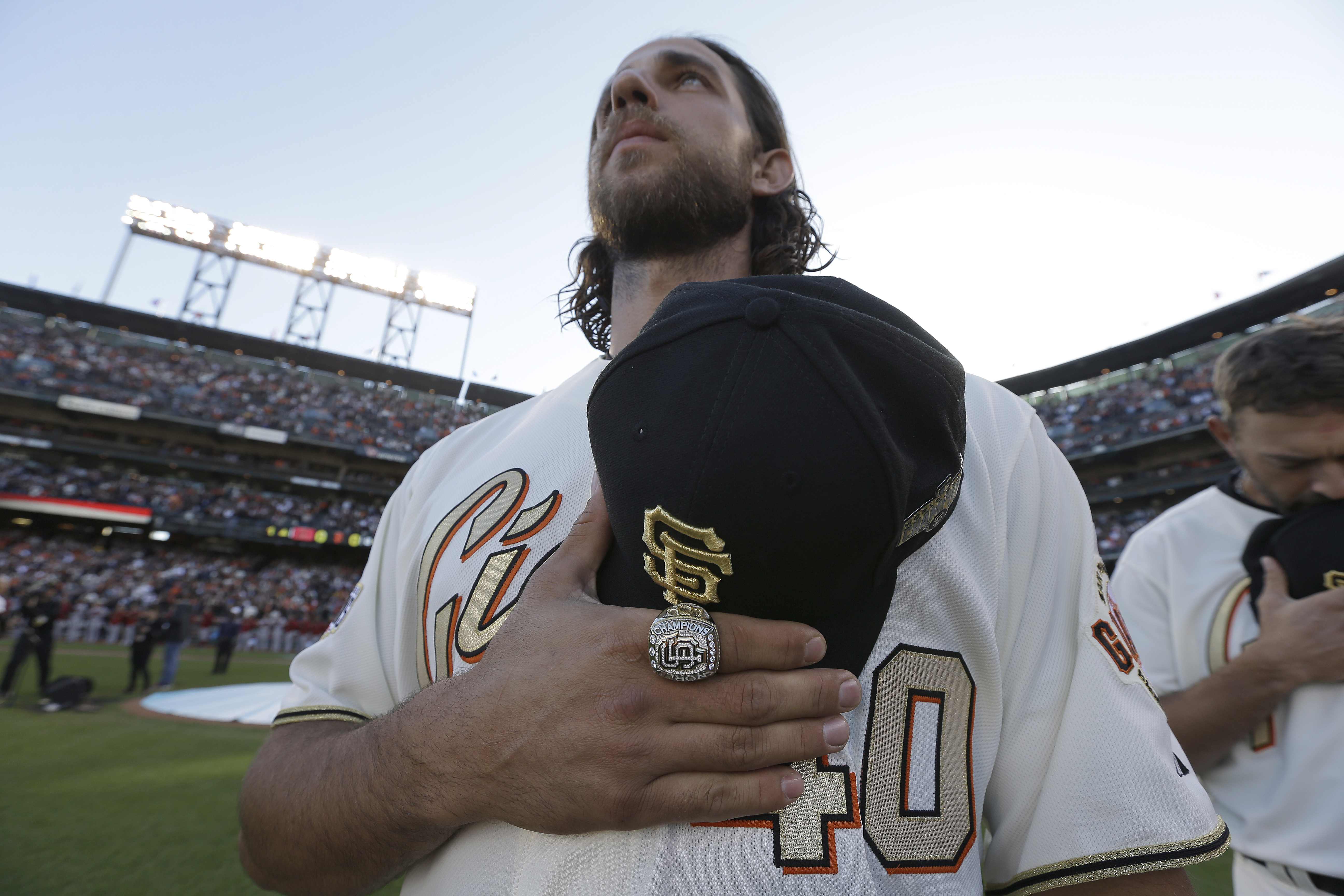<div class='meta'><div class='origin-logo' data-origin='AP'></div><span class='caption-text' data-credit='AP Photo/Ben Margot, Pool'>San Francisco Giants' Madison Bumgarner stands for the national anthem wearing his 2014 World Series championship ring before the baseball game against the Arizona Diamondbacks.</span></div>