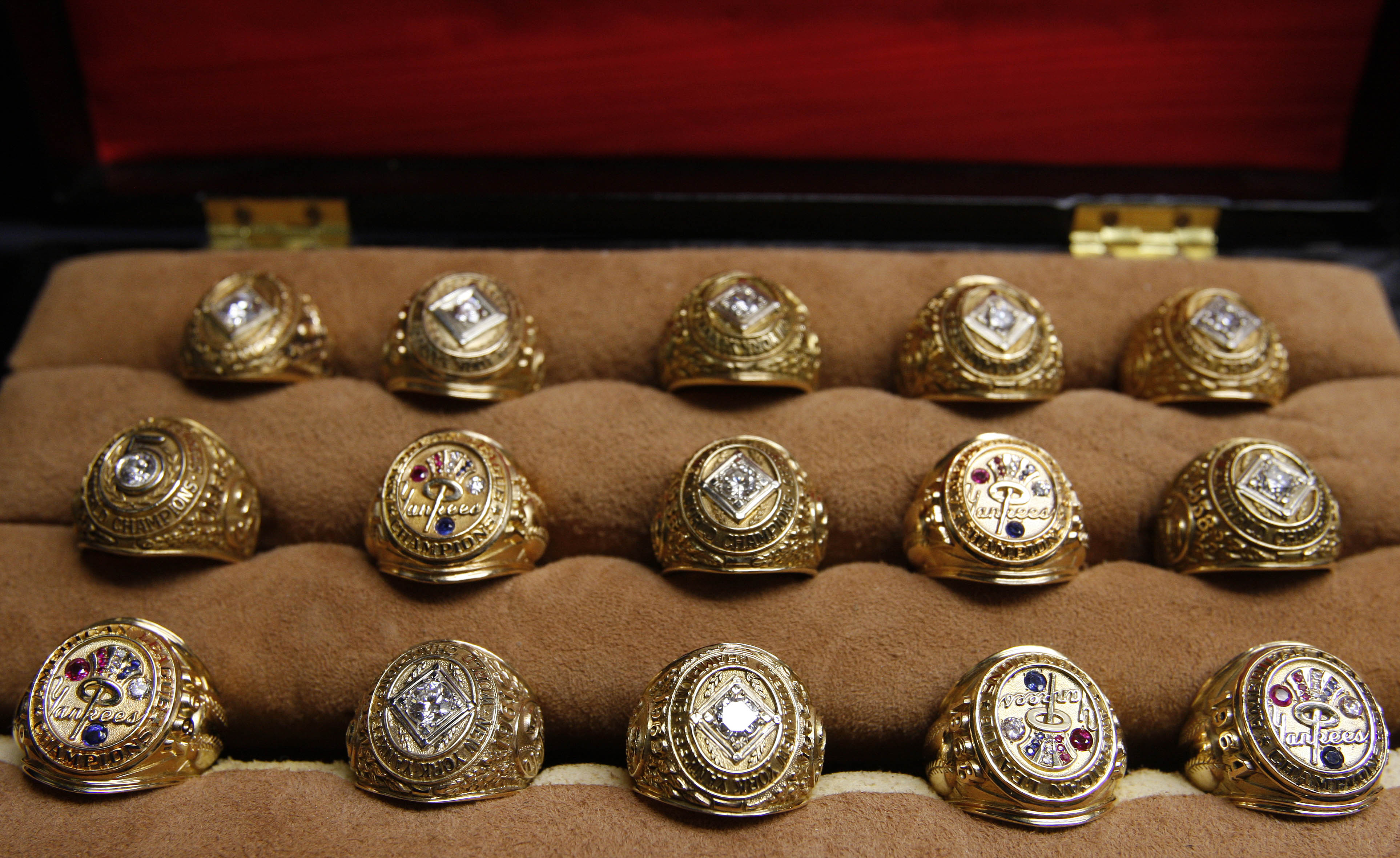 <div class='meta'><div class='origin-logo' data-origin='AP'></div><span class='caption-text' data-credit='AP Photo/Julie Jacobson'>A collection of World Series and American League Championship rings owned by former Yankees' owner Del Webb, is displayed in a case during a preview for a memorabilia auction.</span></div>