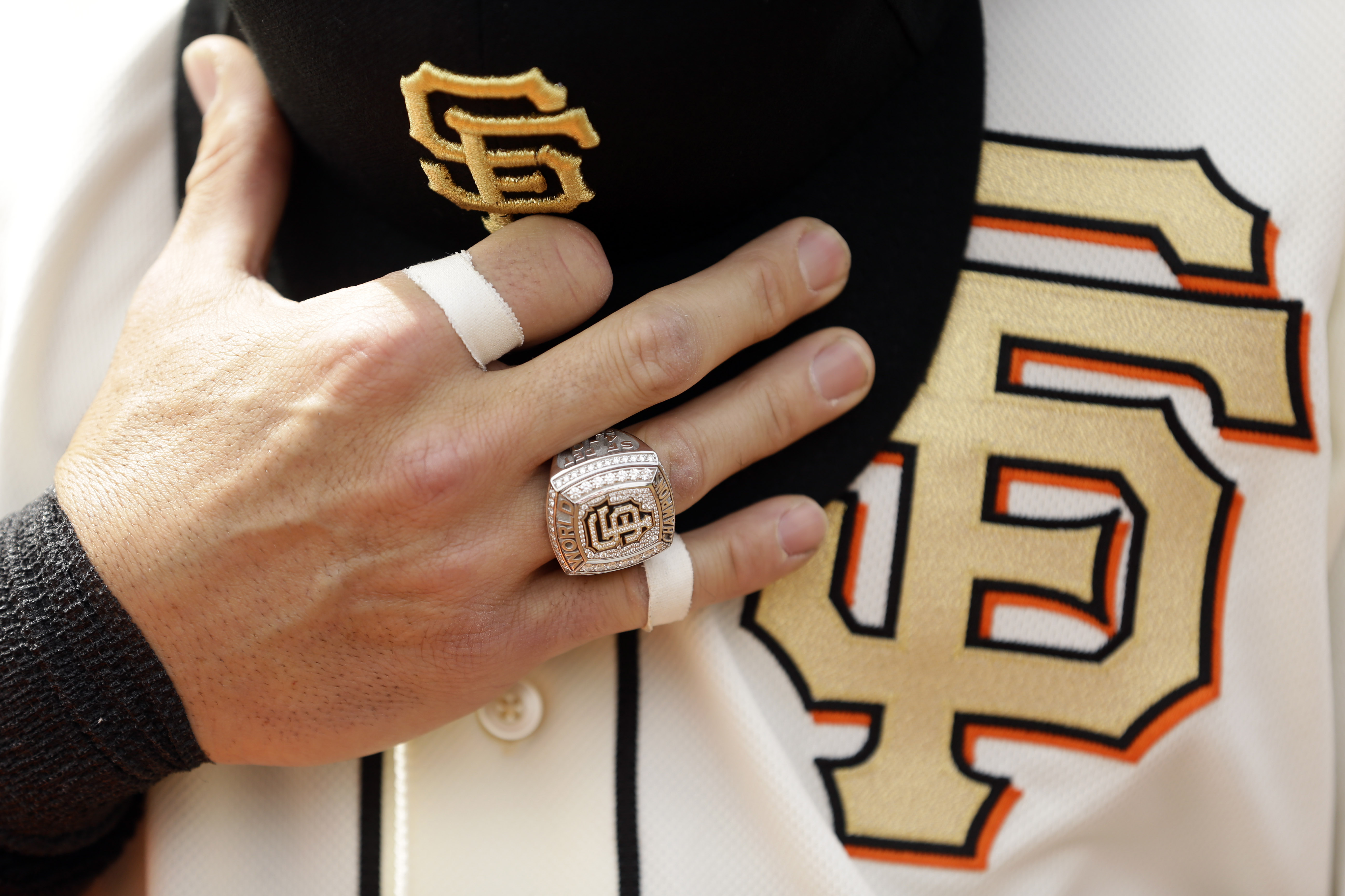 <div class='meta'><div class='origin-logo' data-origin='AP'></div><span class='caption-text' data-credit='AP Photo/Ezra Shaw, Pool'>San Francisco Giants second baseman Marco Scutaro wears ceremony his 2012 World Series Championship ring during the national anthem.</span></div>