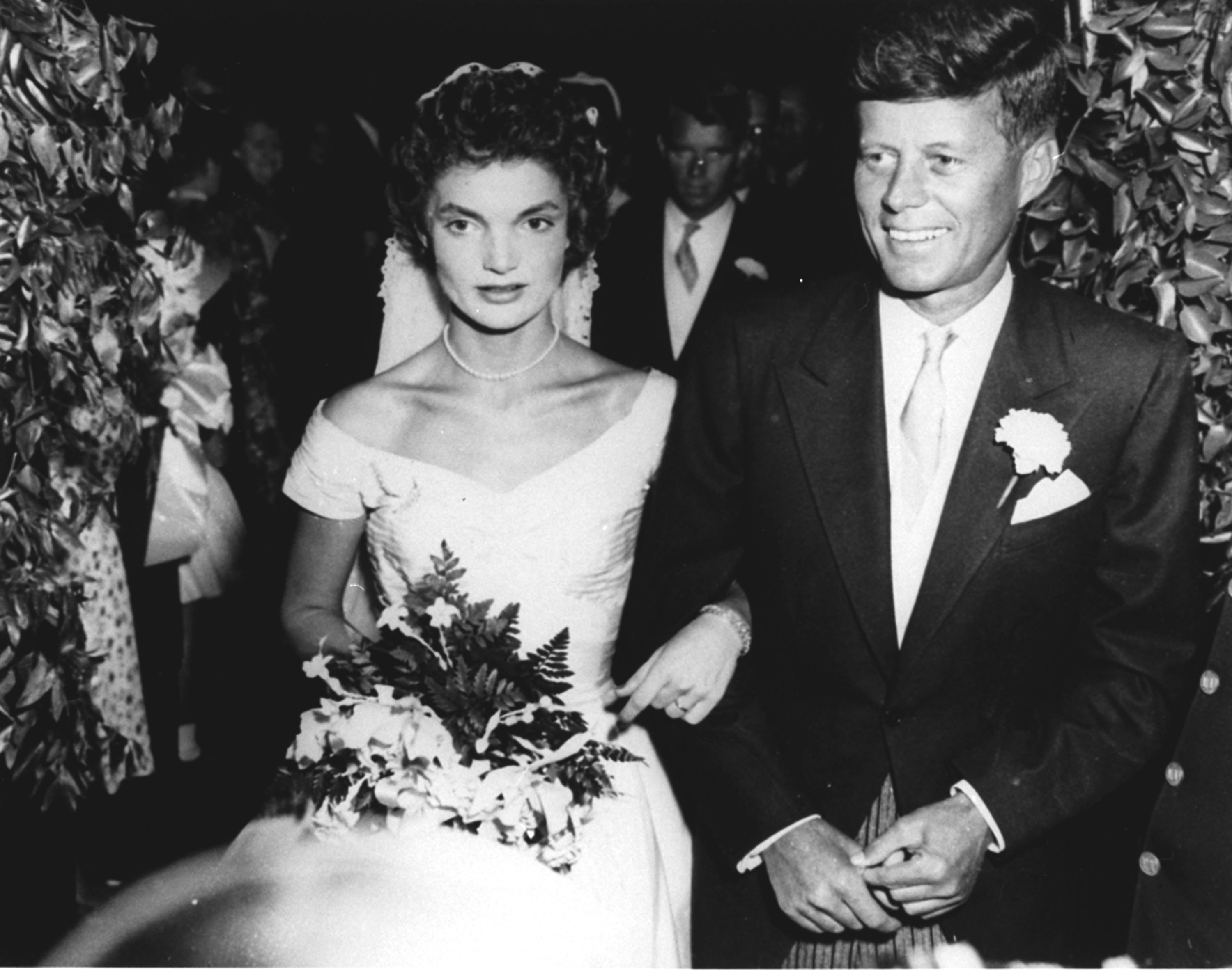 <div class='meta'><div class='origin-logo' data-origin='none'></div><span class='caption-text' data-credit='ASSOCIATED PRESS'>Sen. John F. Kennedy (D-MA) and his bride, the former Jacqueline Lee Bouvier, leave St. Mary's Catholic Church following their wedding in Newport, RI, September 12, 1953.</span></div>