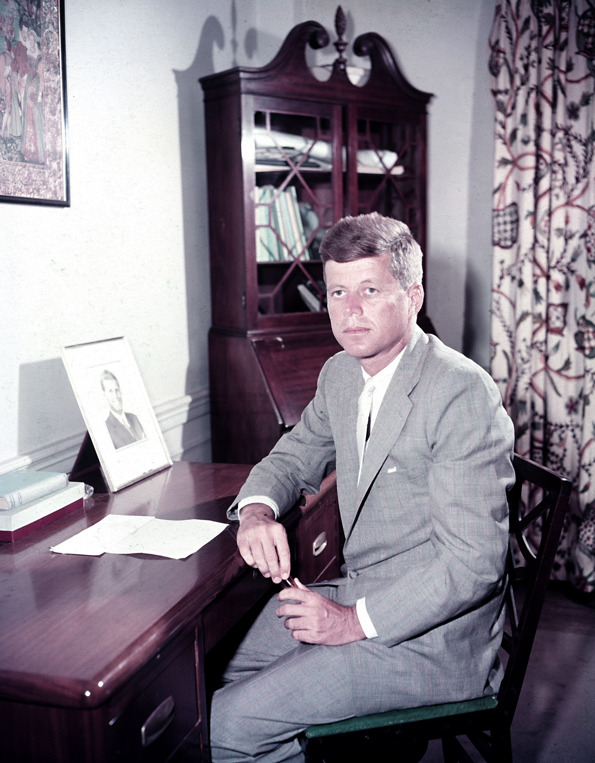<div class='meta'><div class='origin-logo' data-origin='none'></div><span class='caption-text' data-credit='AP'>Senator John F. Kennedy (D-Mass.), seated at his desk in Boston, Mass., August 1956.</span></div>