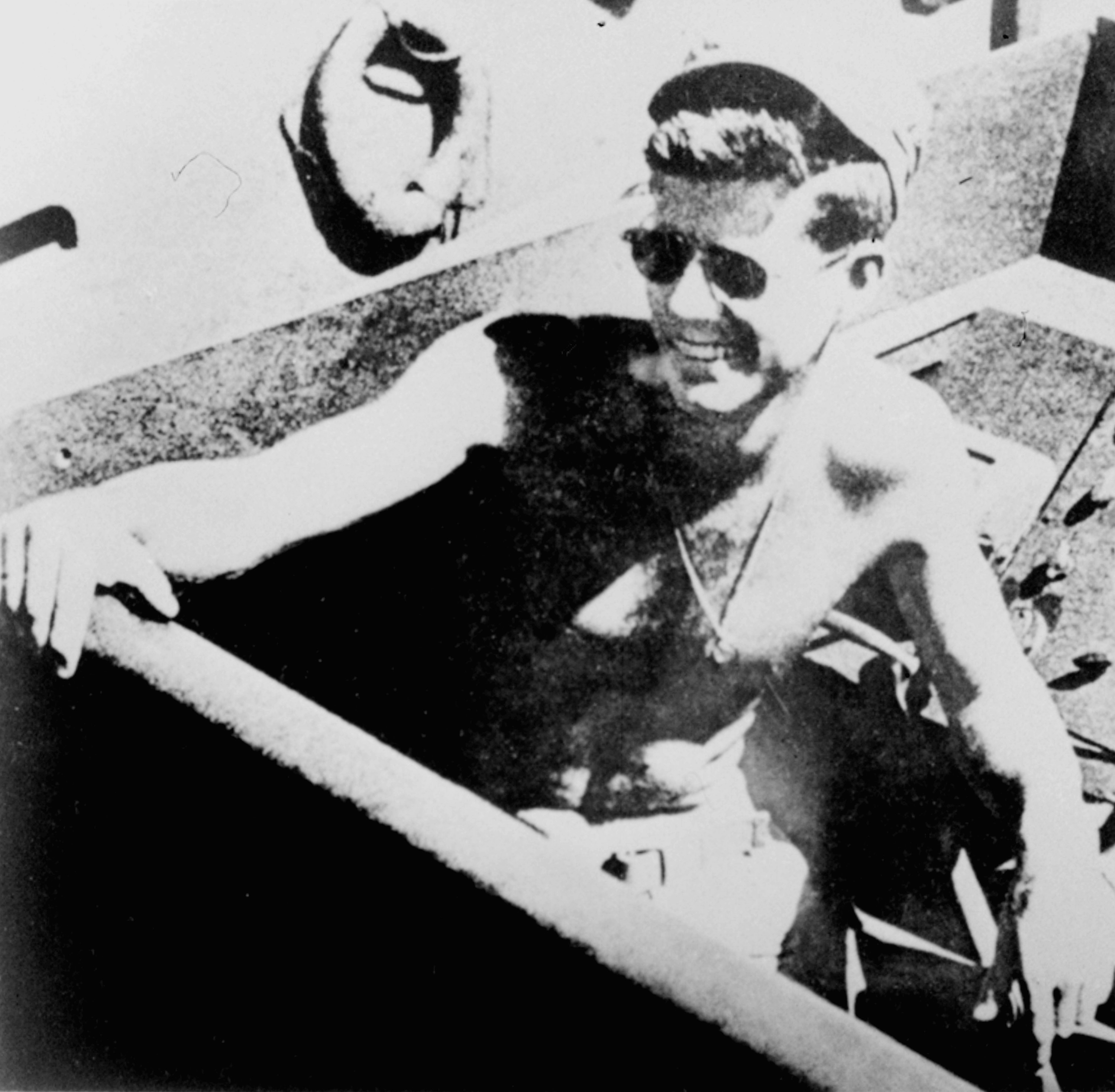 <div class='meta'><div class='origin-logo' data-origin='none'></div><span class='caption-text' data-credit='ASSOCIATED PRESS'>Lt. John F. Kennedy, skipper of PT boat 109, is shown relaxing in the South Pacific, 1943.</span></div>