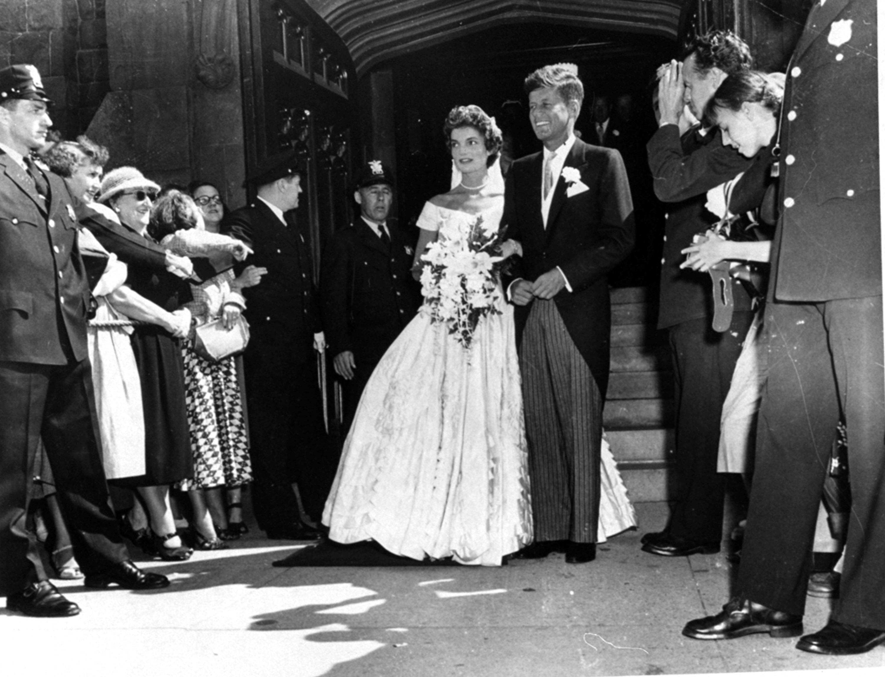 <div class='meta'><div class='origin-logo' data-origin='none'></div><span class='caption-text' data-credit='AP'>Senator John F. Kennedy, D-Mass., is shown with his bride, the former Jacqueline Bouvier, leaving a Newport, RI church after their wedding on September 12, 1953.</span></div>