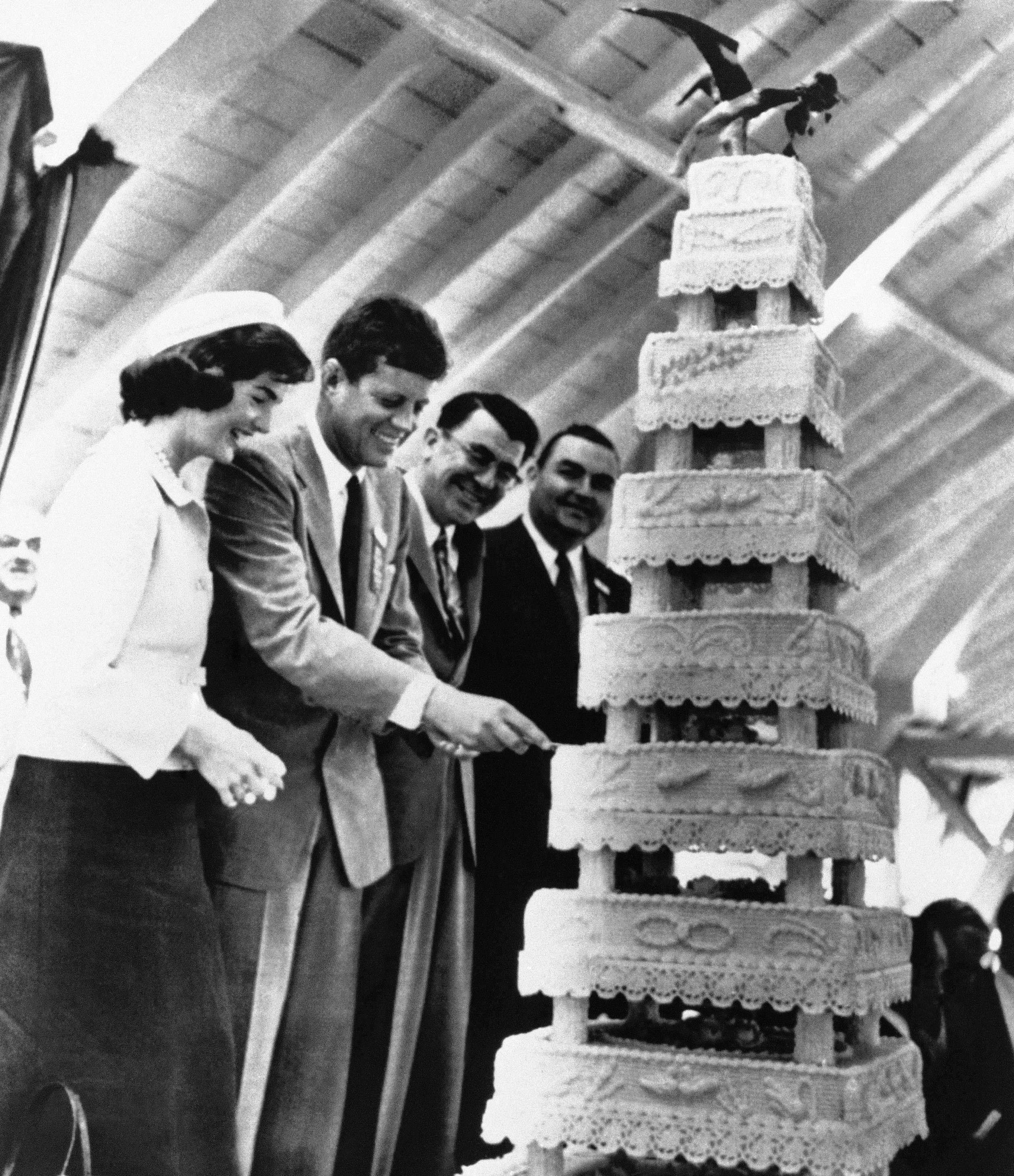 <div class='meta'><div class='origin-logo' data-origin='none'></div><span class='caption-text' data-credit='ASSOCIATED PRESS'>U.S. Senator John F. Kennedy (D) of Mass. slices to birthday cake in his honor celebrating his the birthday which fell on May 29, 1956 in Lincoln Park, Mass.</span></div>