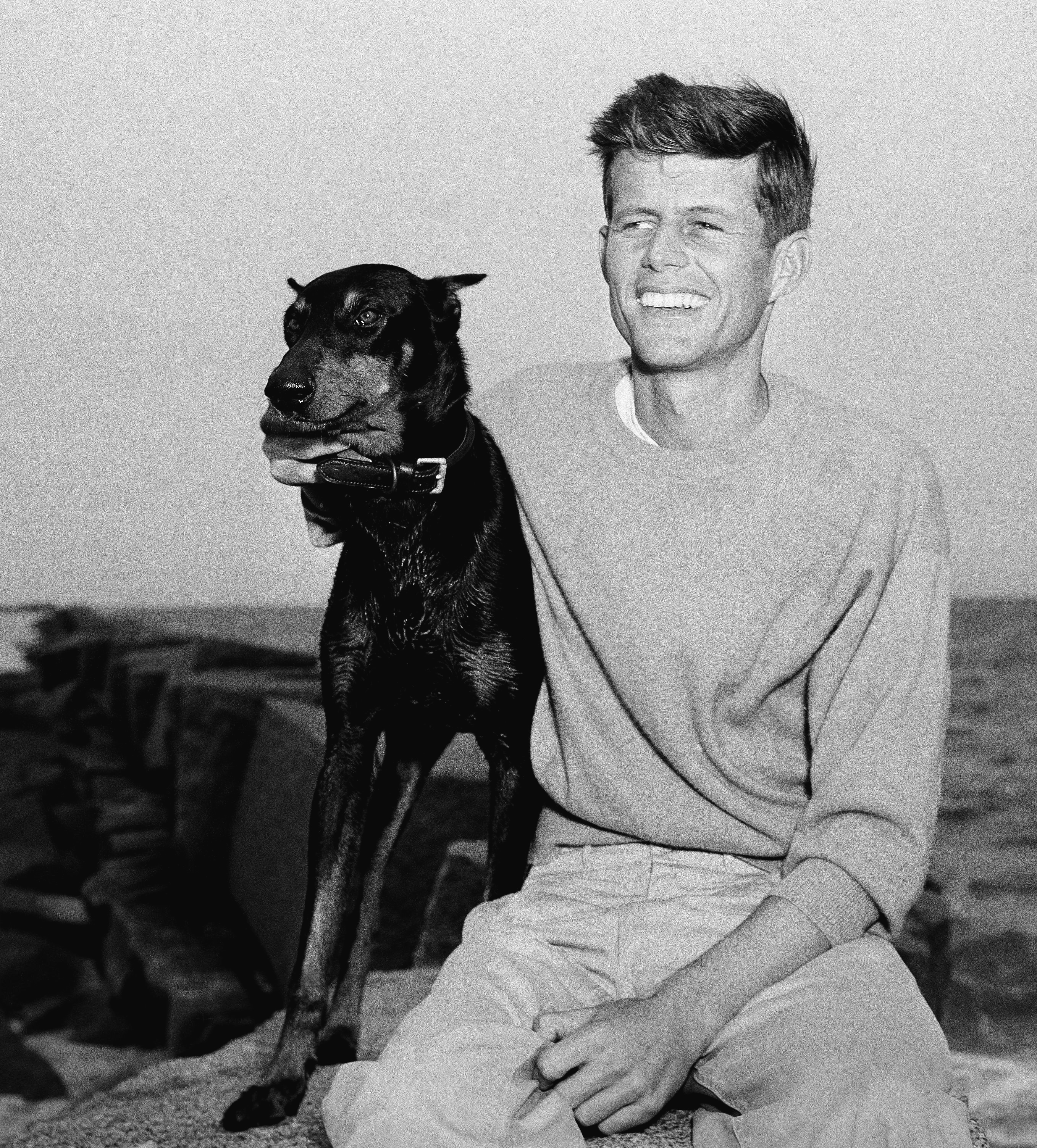 <div class='meta'><div class='origin-logo' data-origin='none'></div><span class='caption-text' data-credit='AP Photo/Peter J. Carroll'>John F. Kennedy, winner of the Democratic Nomination for Congress in the 11th Massachusetts District, relaxes with his dog, Mo, June 22, 1946, Hyannisport, Mass.</span></div>