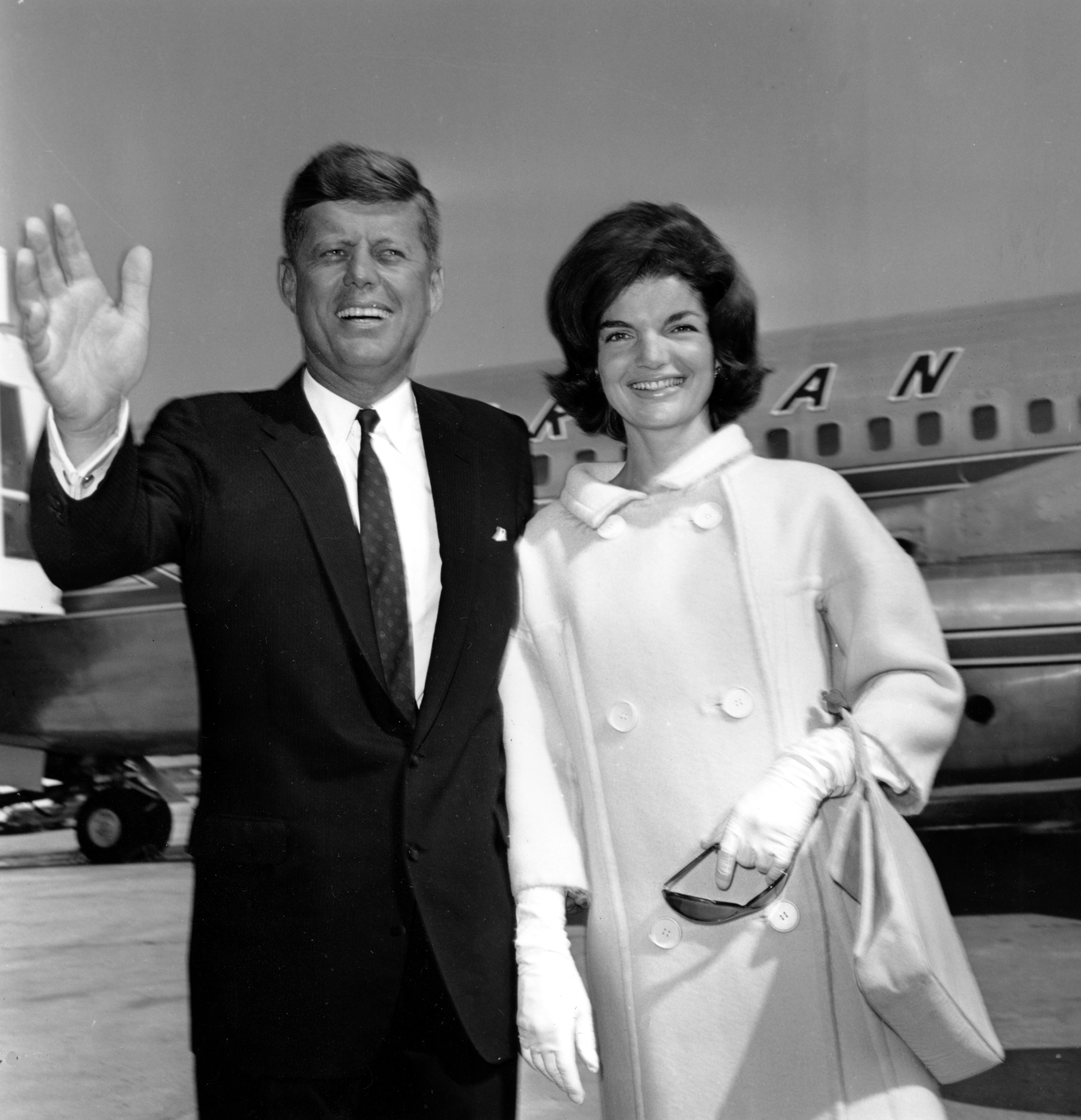 <div class='meta'><div class='origin-logo' data-origin='none'></div><span class='caption-text' data-credit='ASSOCIATED PRESS'>Sen. John F. Kennedy waves farewell as he poses with his wife, Jacqueline Kennedy, at New York's Idlewild Airport in New York City on July 9, 1960.</span></div>