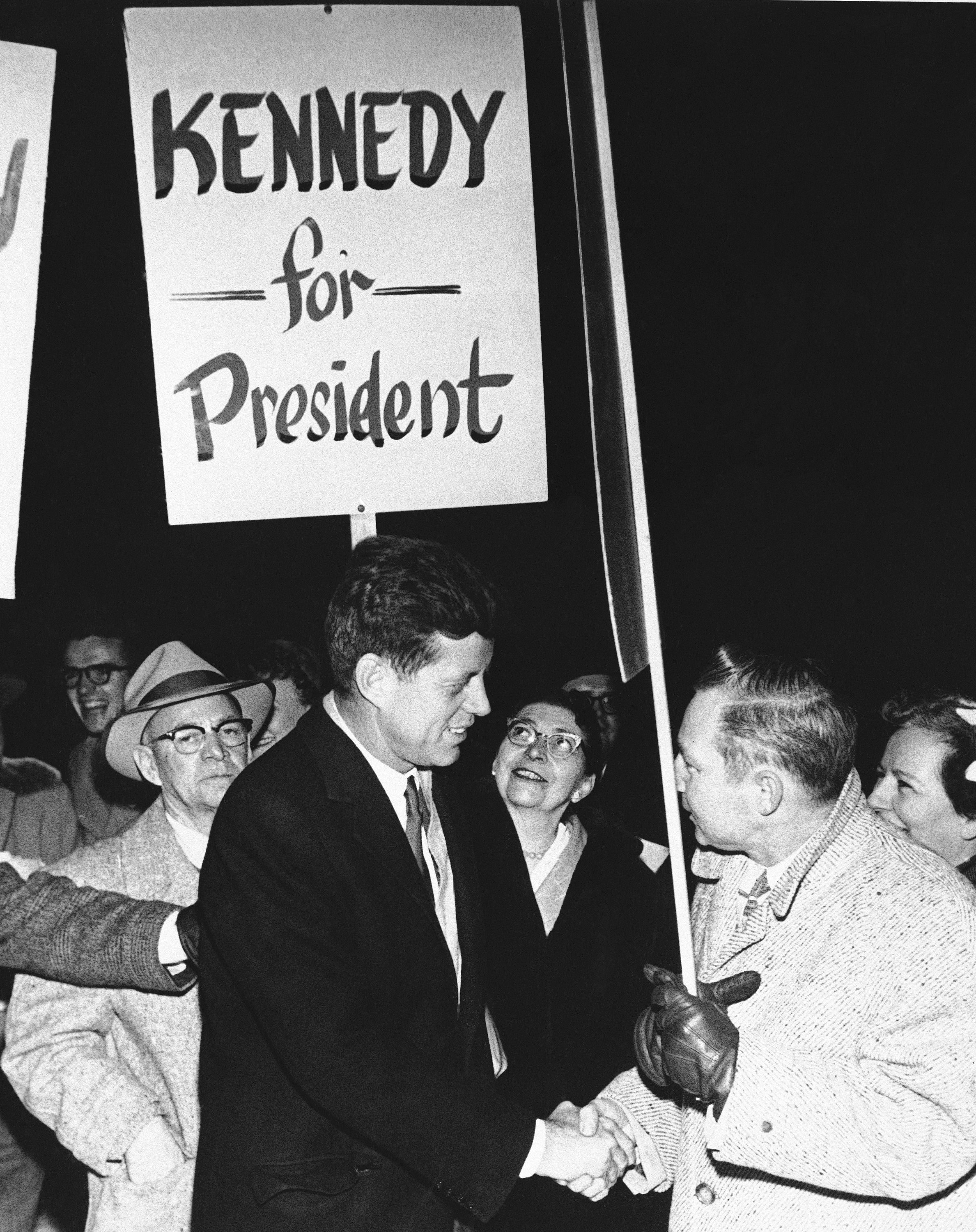 <div class='meta'><div class='origin-logo' data-origin='none'></div><span class='caption-text' data-credit='AP'>Sen. John F. Kennedy of Mass gets some support from a group of Anchorage residents on his arrival in Anchorage, Nov. 12, 1958.</span></div>