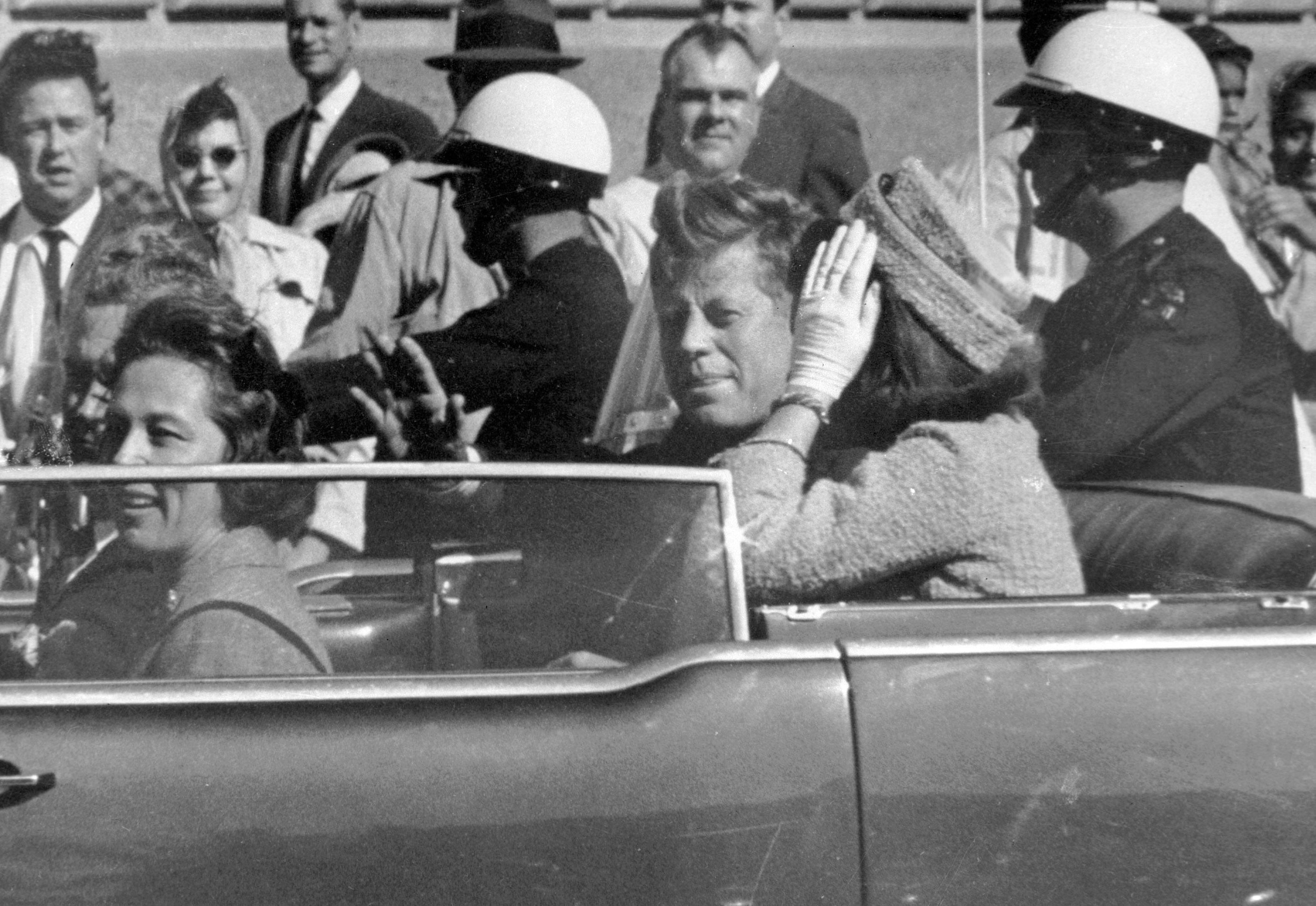 <div class='meta'><div class='origin-logo' data-origin='none'></div><span class='caption-text' data-credit='Jim Altgens/AP Photo'>n this Nov. 22, 1963 file photo, President John F. Kennedy waves from his car in a motorcade approximately one minute before he was shot in Dallas.</span></div>