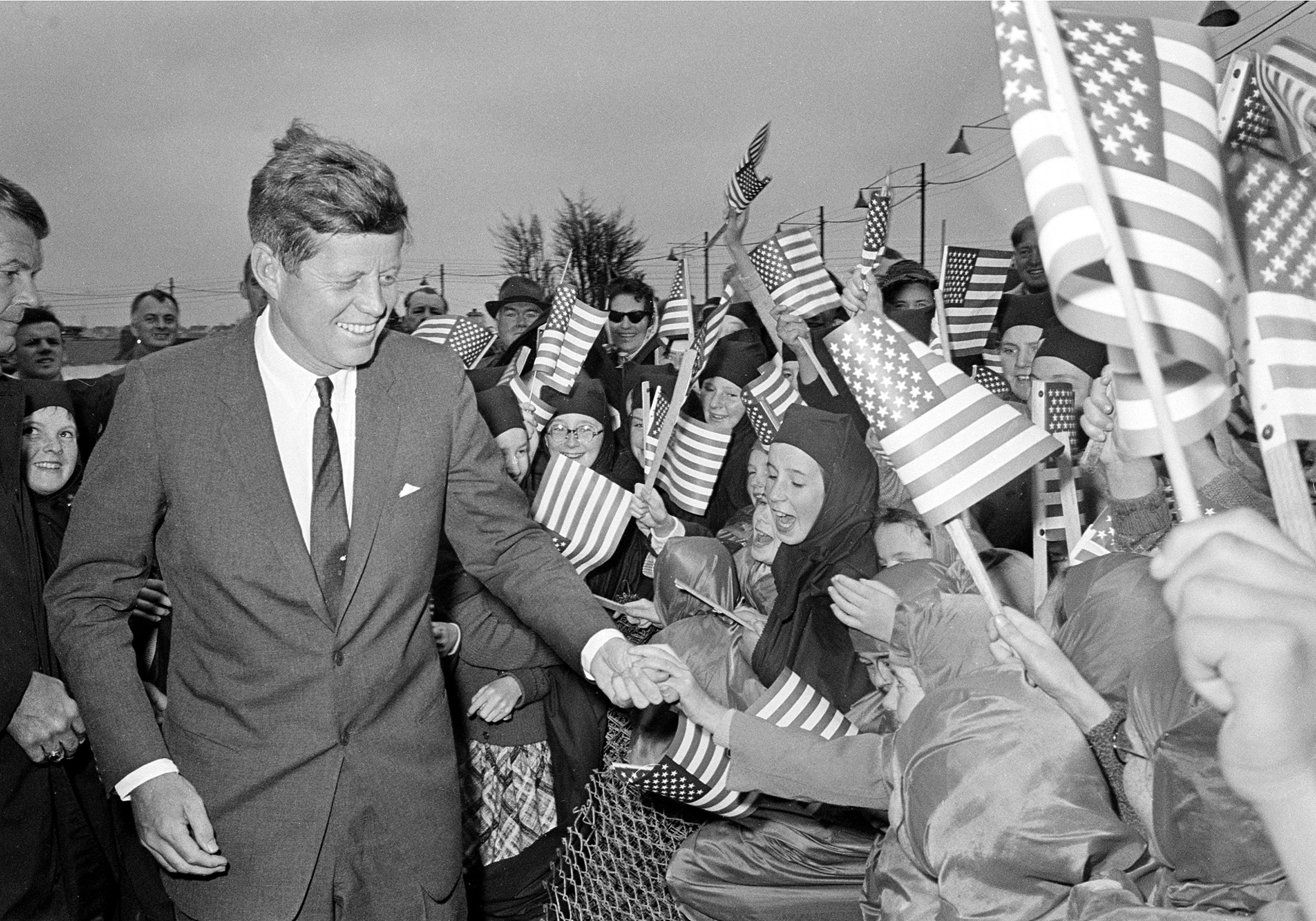 <div class='meta'><div class='origin-logo' data-origin='none'></div><span class='caption-text' data-credit='ASSOCIATED PRESS'>Kennedy is greeted by an enthusiastic crowd of children and nuns from the Convent of Mercy, as he arrives from Dublin at Galway's sports ground, Ireland, June 29, 1963.</span></div>