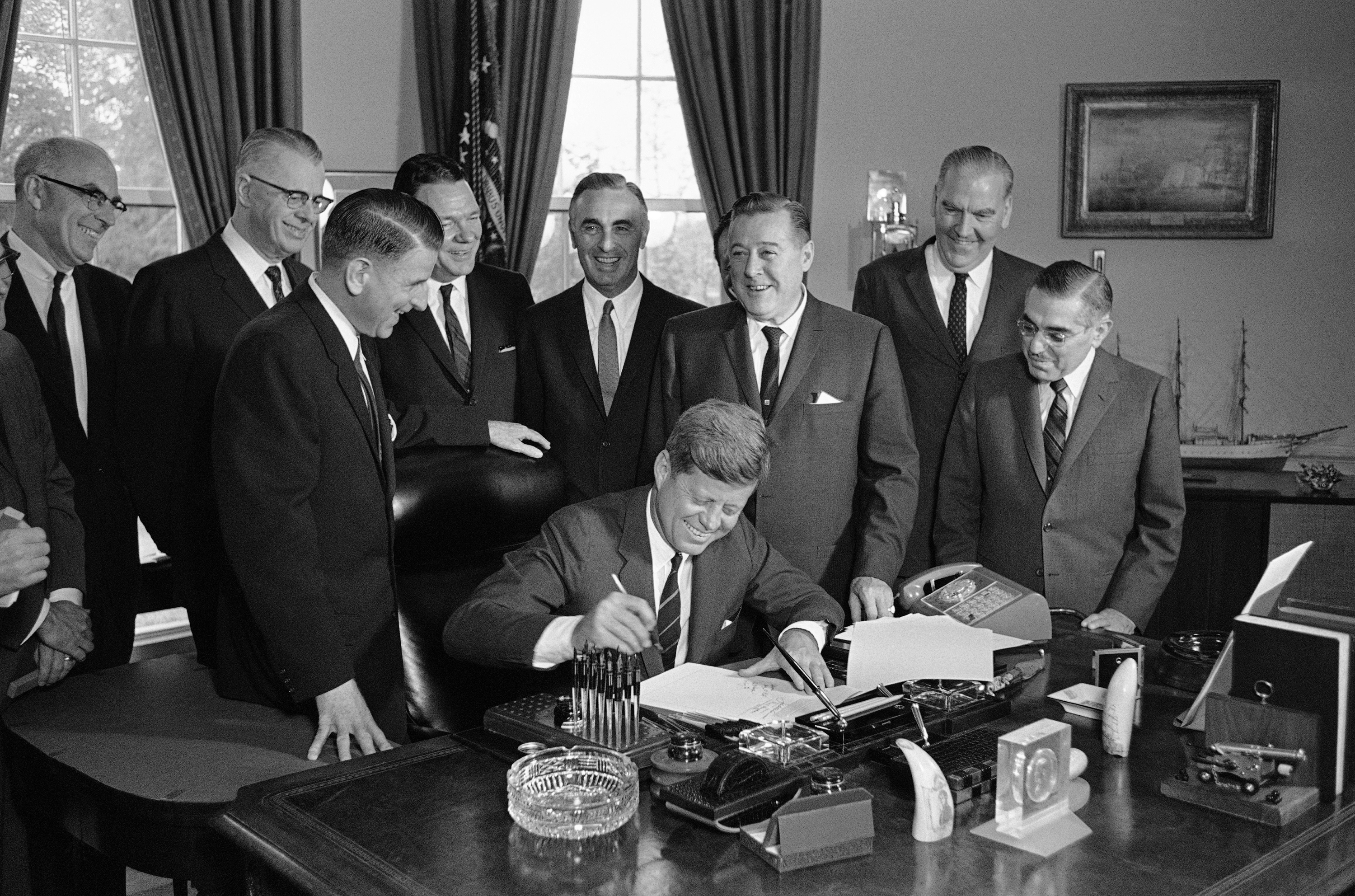 <div class='meta'><div class='origin-logo' data-origin='none'></div><span class='caption-text' data-credit='Harvey Georges/AP Photo'>President John F. Kennedy signs into law a bill providing federal aid for an expansion of educational television stations all over the nation. May 1, 1962 at the White House.</span></div>